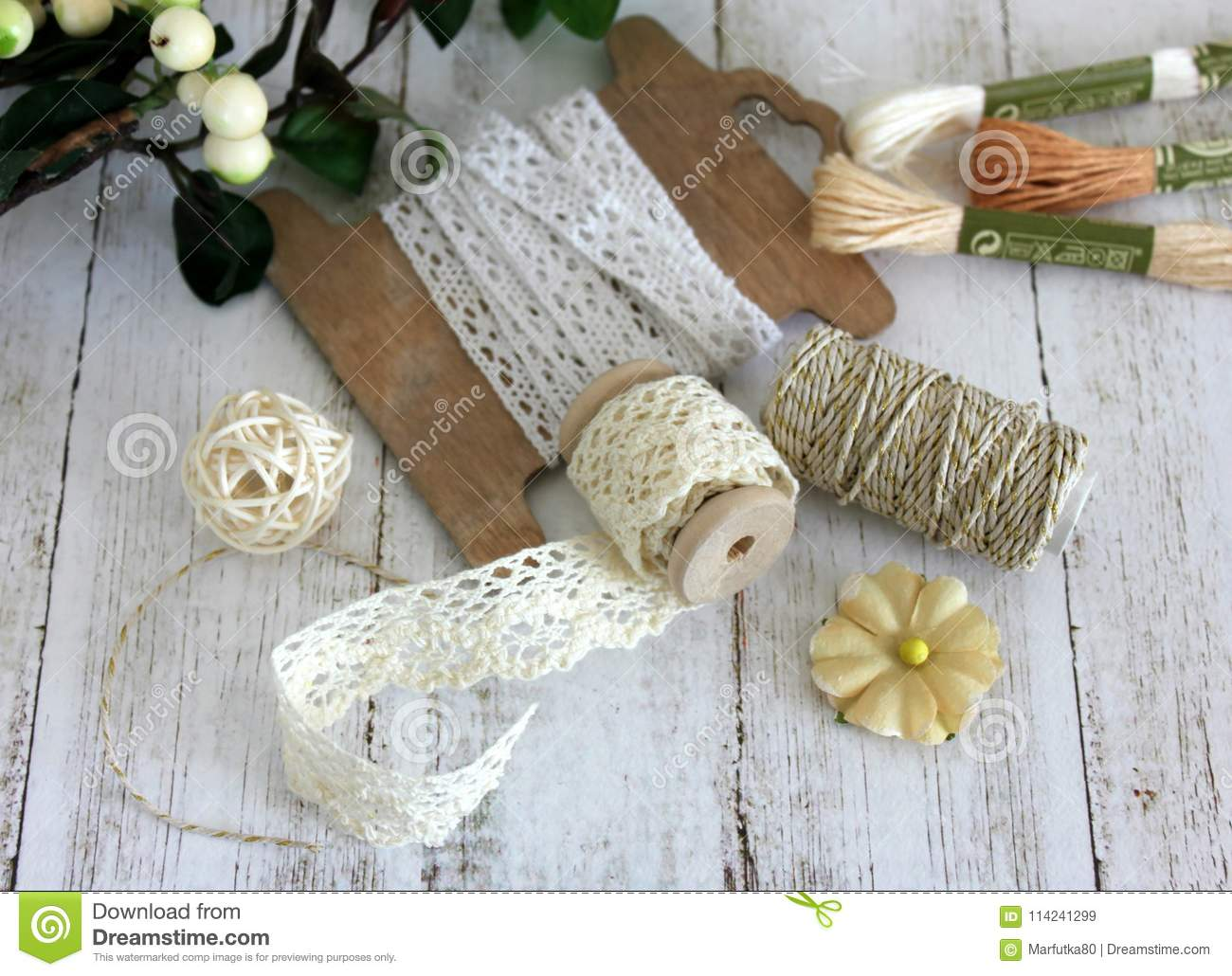 Spools with lace trim and baker`s twine. Laces and trims. Crafting and sewing supplies