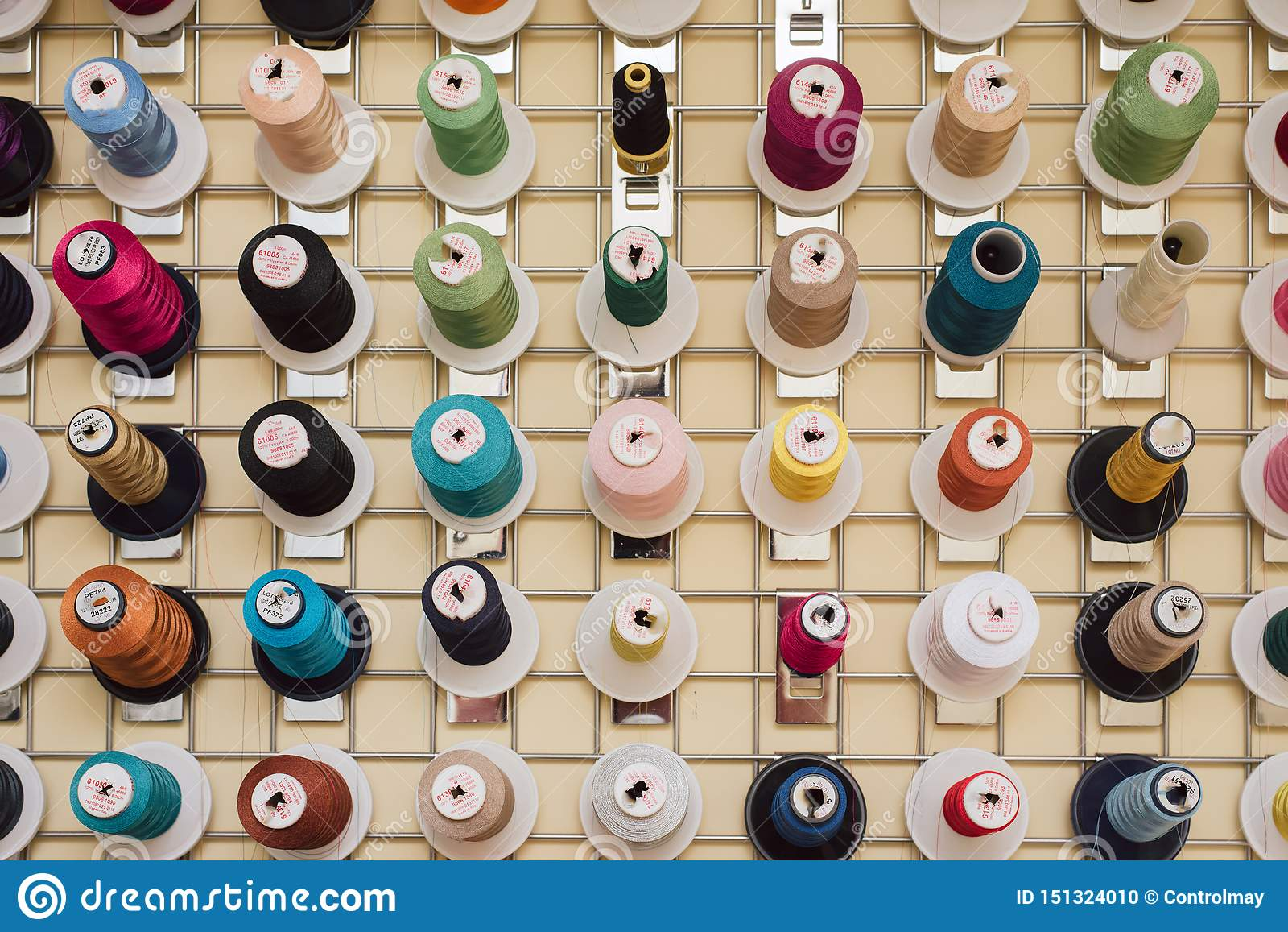 Spools of thread hanging in a tailor shop. Skeins for sewing machine hang in a sewing shop