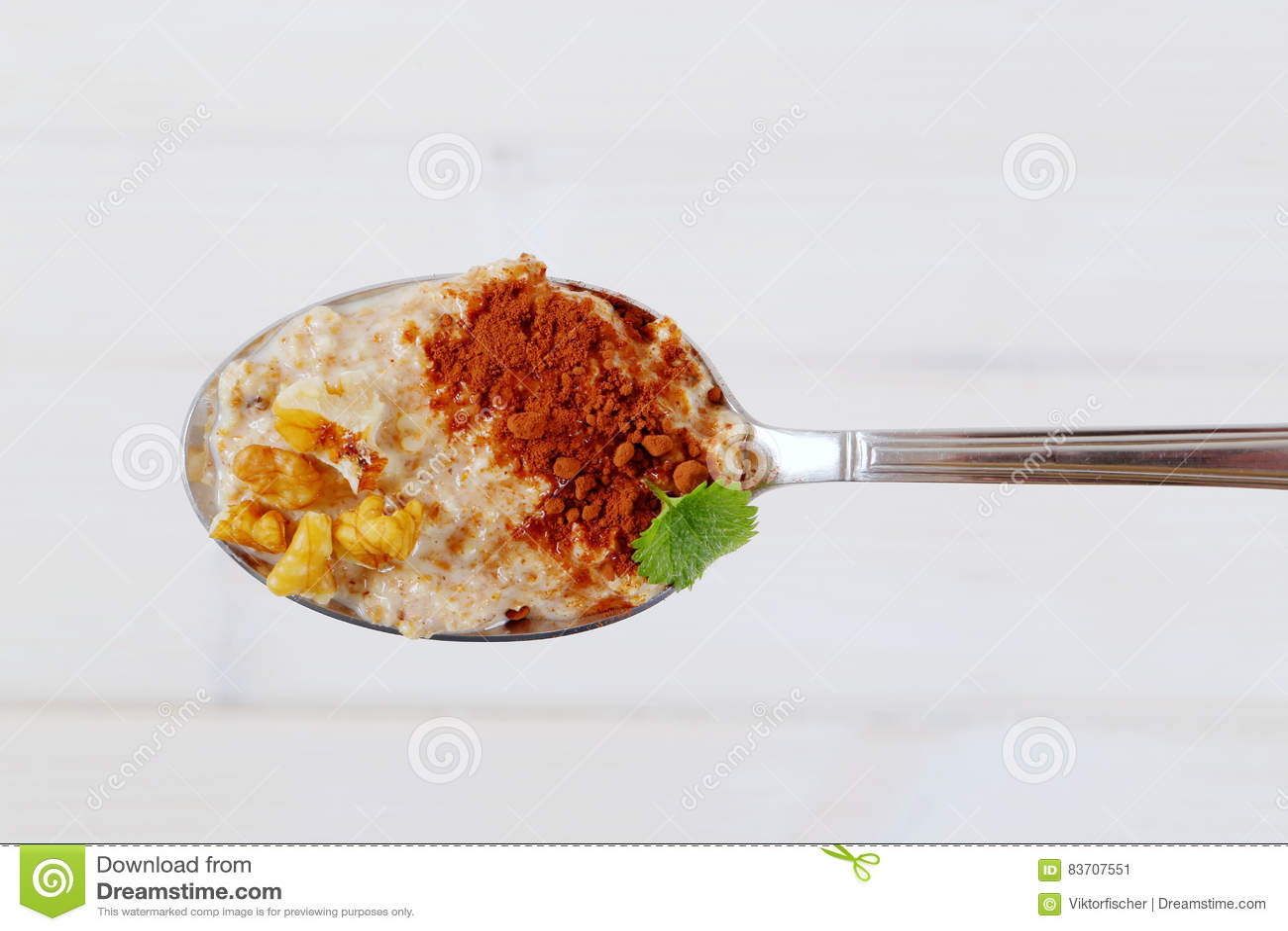 Spoon Of Oatmeal Porridge With Cinnamon And Walnuts Stock Photo