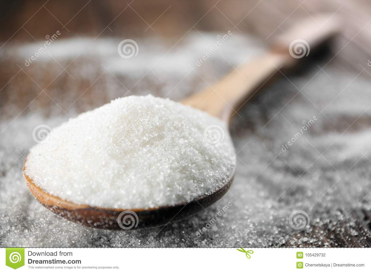 Spoon with white sugar