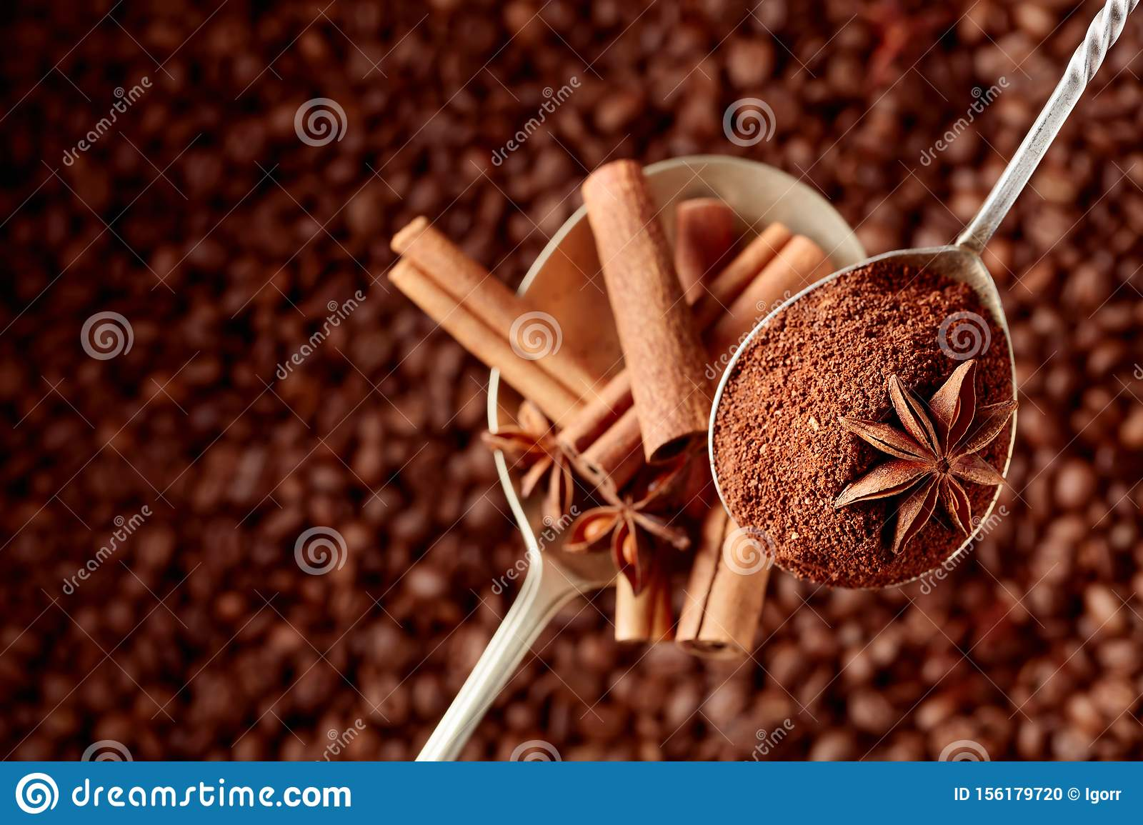 Spoons of ground coffee and anise with cinnamon sticks