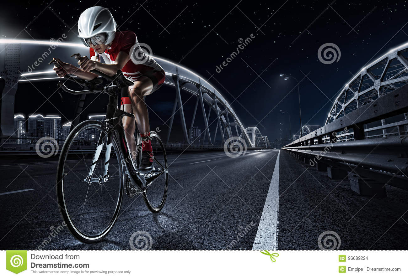 Sport backgrounds. Athletic woman cycling road bike.
