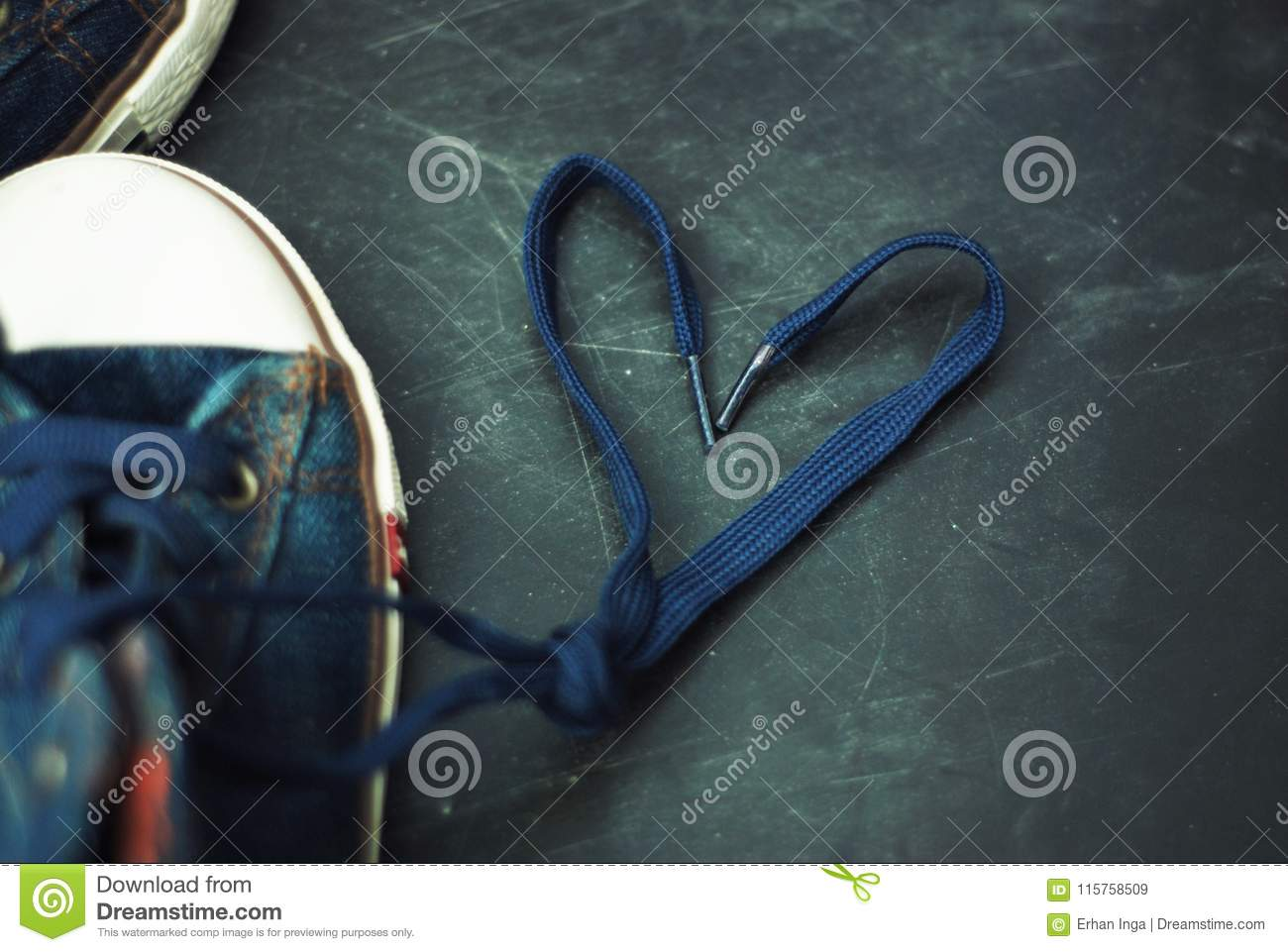 Sport blue Jeans Boots Children Heart Shape Laces over Textured Grounge Chalckboard. Toned. Education and Parenting