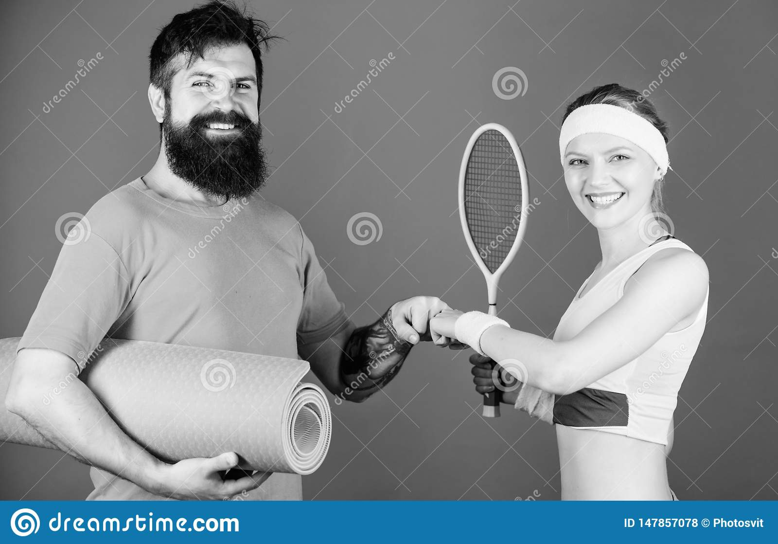 Sport coach. Athletic Success. Sporty couple training with coach. Strong muscles and body. Sport equipment. Happy woman