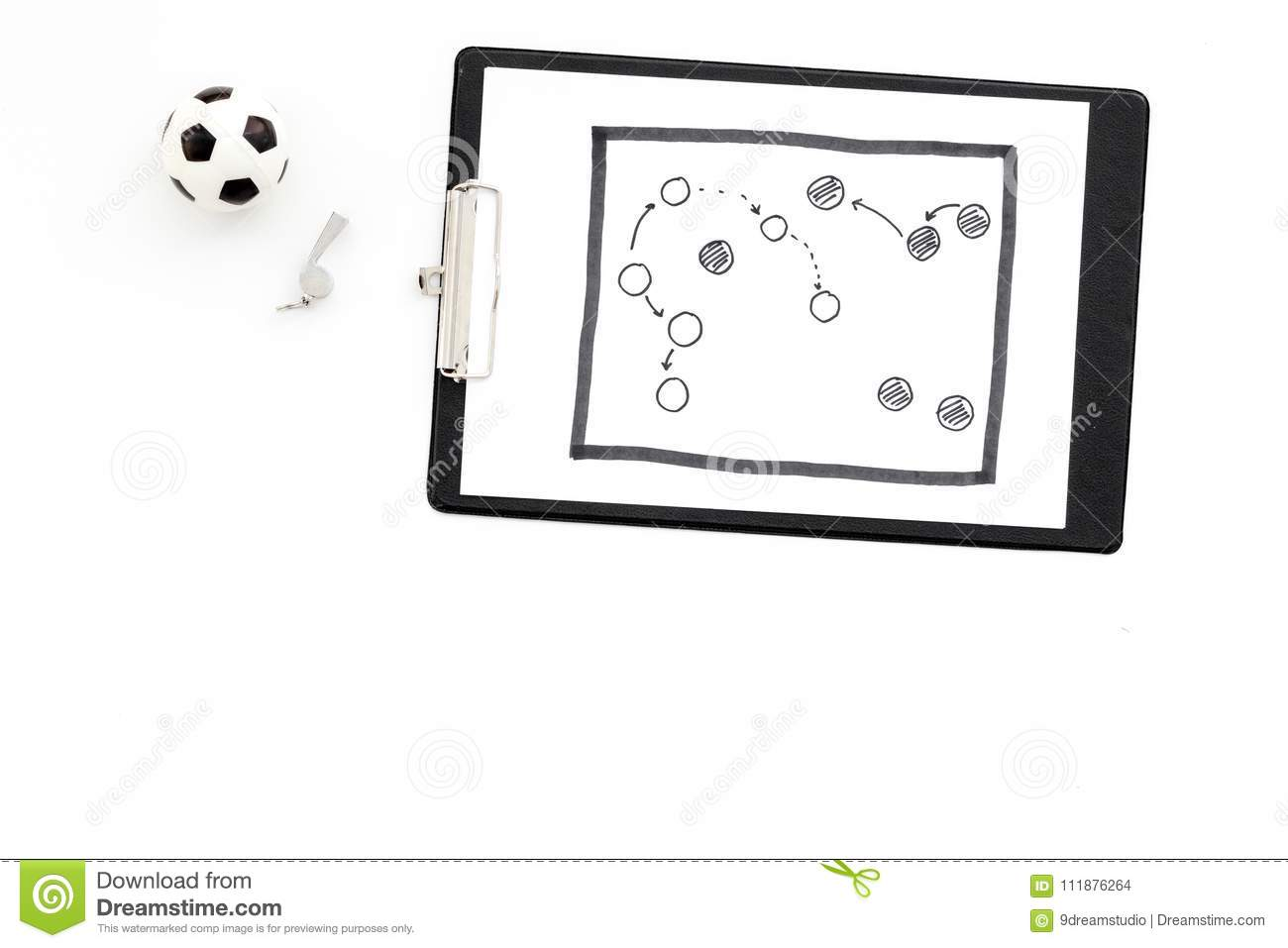 Sport coach concept. Pad with tactic plan of the match near whistle and football ball on white background top view copy