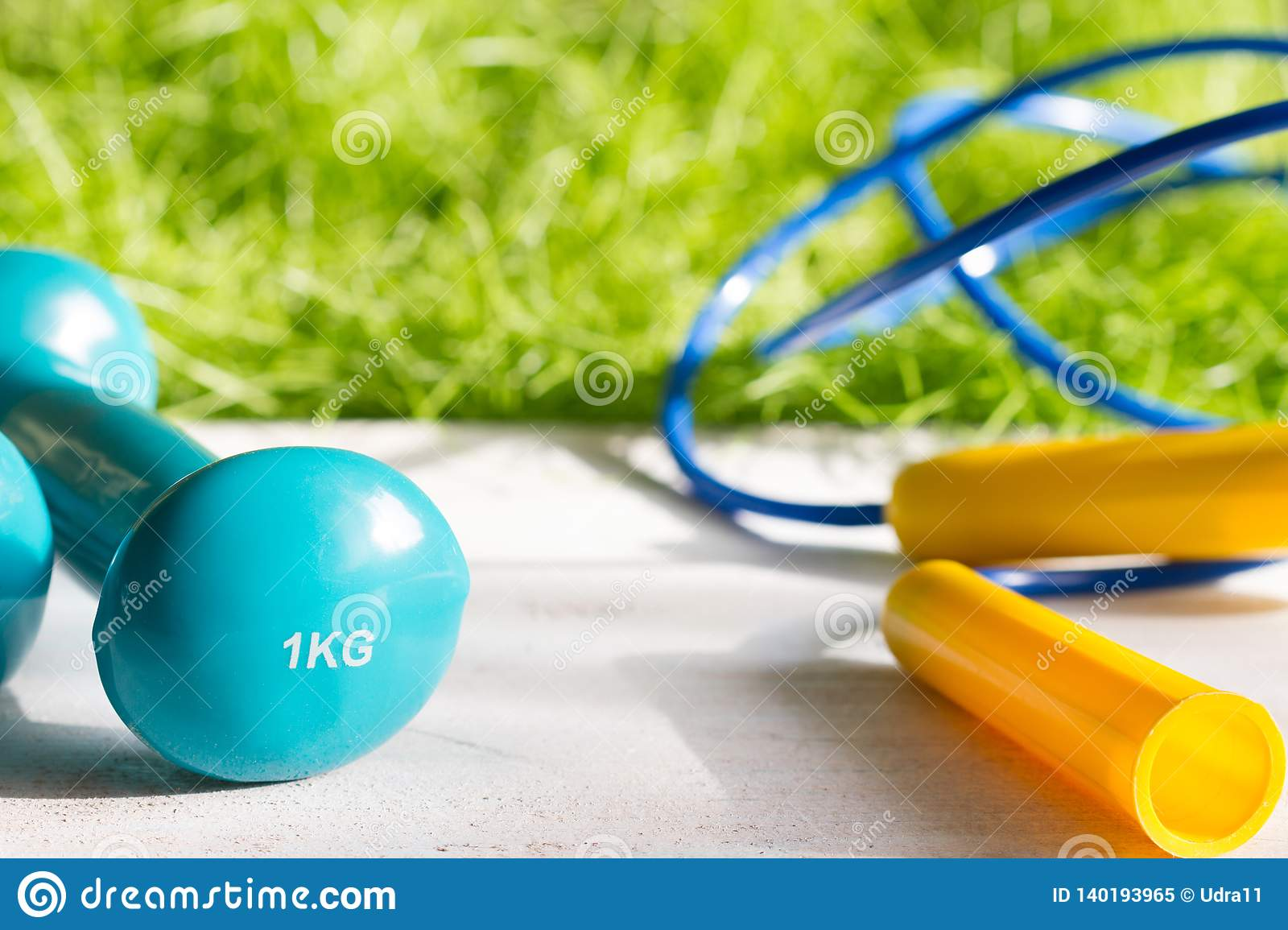 Sport diet and active healthy lifestyle springtime concept with outdoor exercise equipment