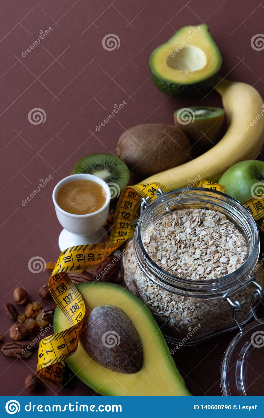 Sport and diet concept. Ingredients for healthy breakfast on brown background.