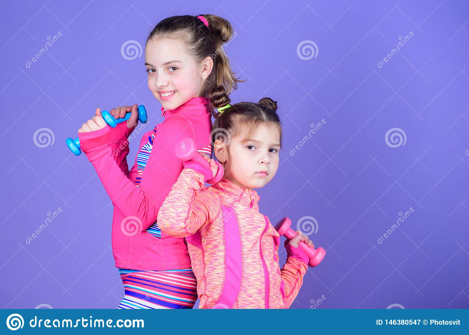 Sport exercises for kids. Healthy upbringing. Sporty babies. Following her sister. Girls cute kid exercising with
