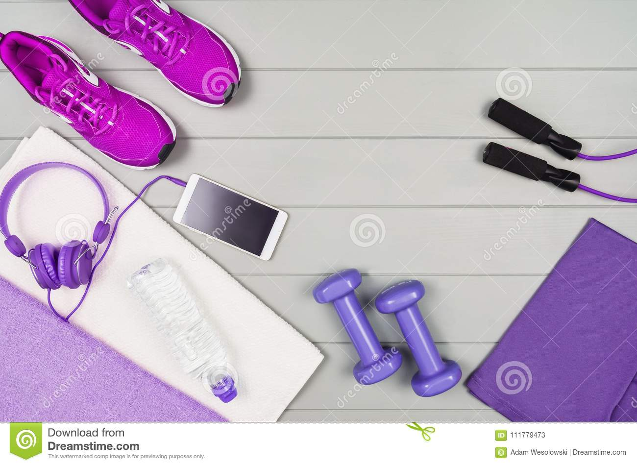 Sport fitness accessories on wooden background mock up, top view