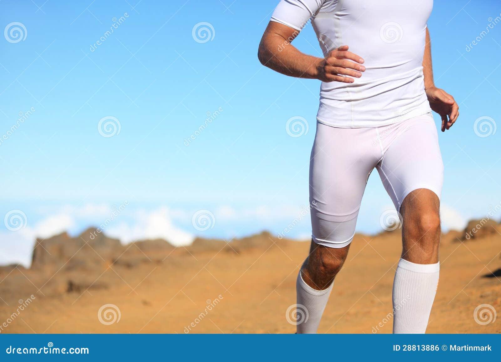 Sport fitness runner running outside in nature man training trail