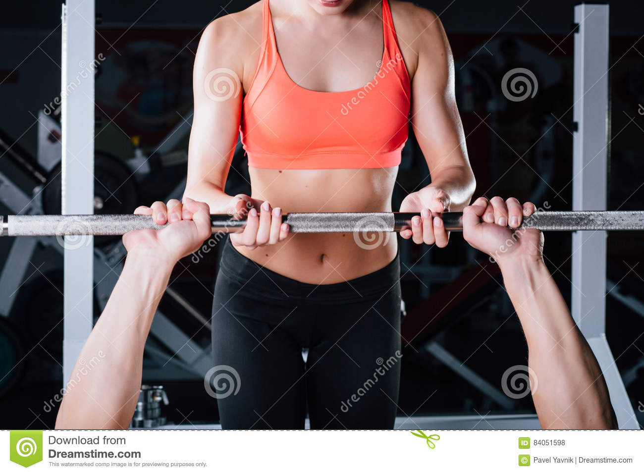 Sport, fitness, teamwork, weightlifting and people concept - young girl personal trainer work with man barbell