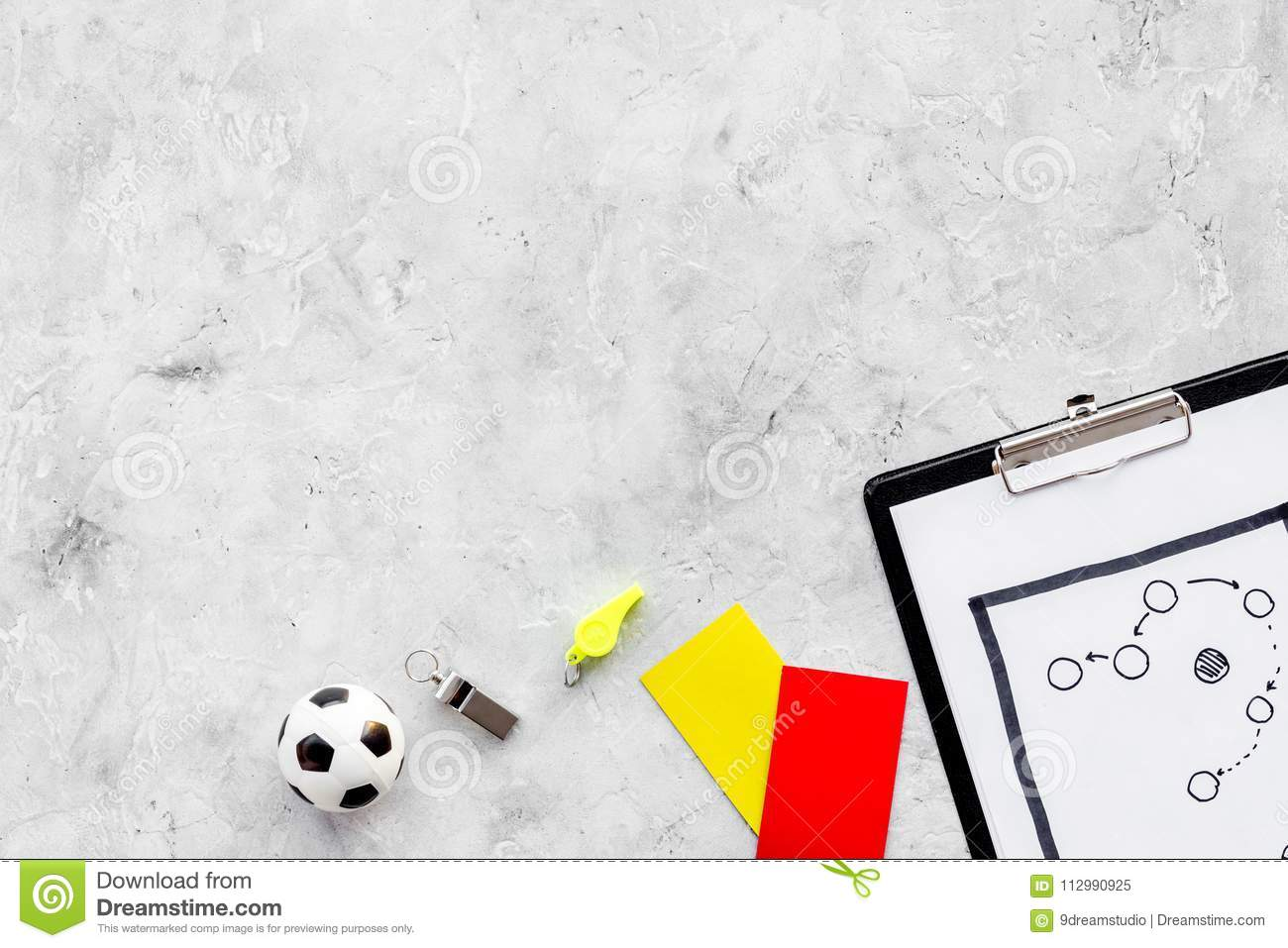 Sport judging concept. Soccer referee. Tactic plan for game, football ball, red and yellow cards, whistle on stone