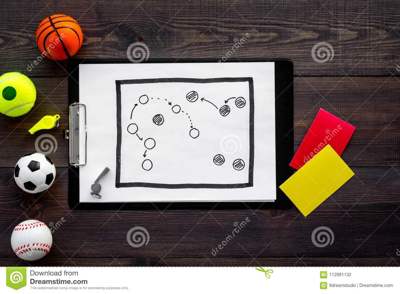 Sport judging concept. Sport game referee. Tactic plan for game, balls, red and yellow cards, whistle on wooden