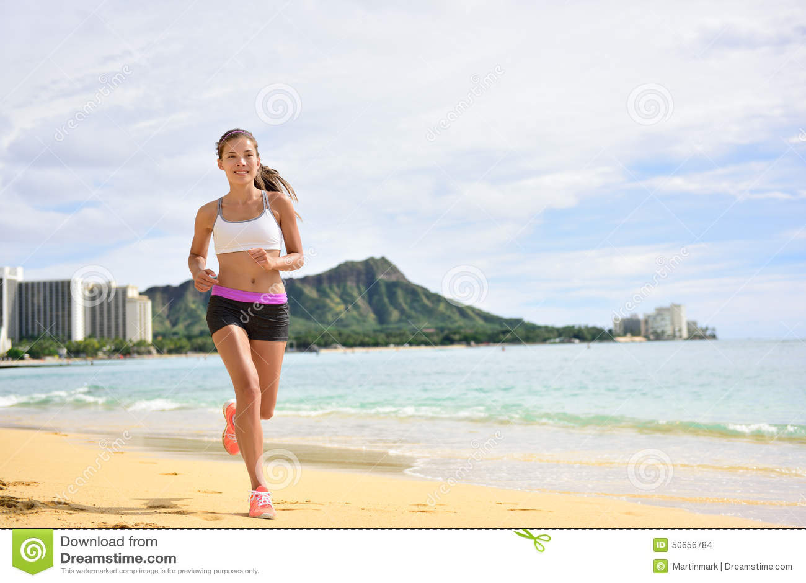 Sport running fitness woman jogging on beach run
