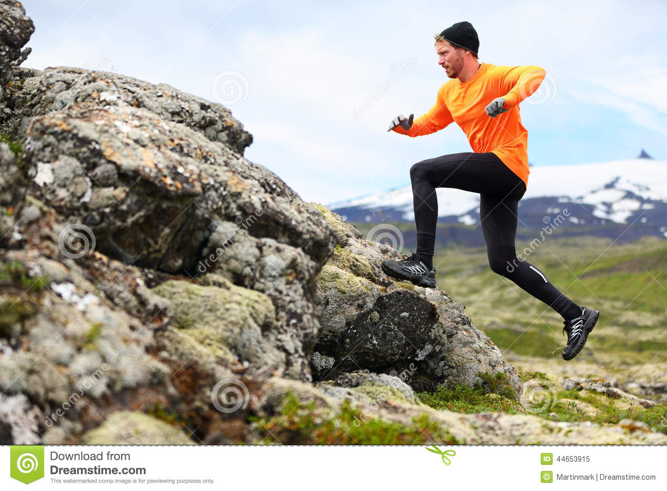 Sport running man in cross country trail run fit male runner exercise