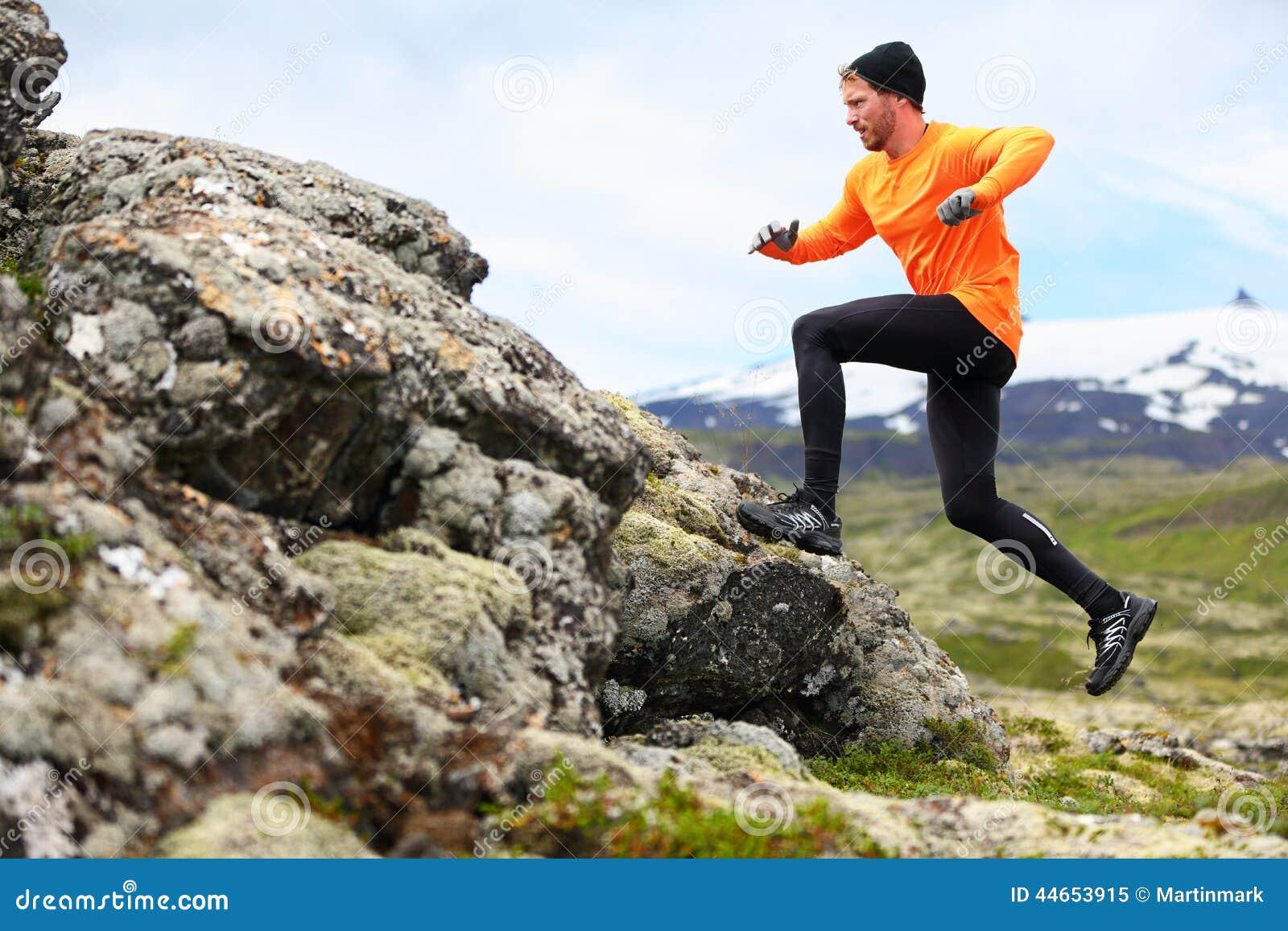 Sport running man in cross country trail run