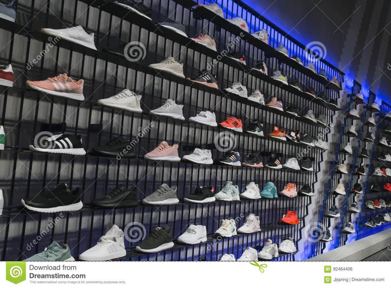 free shipping a9562 c906d Interior of Adidas sports retail boutique outlet with sport shoes on  shelves.