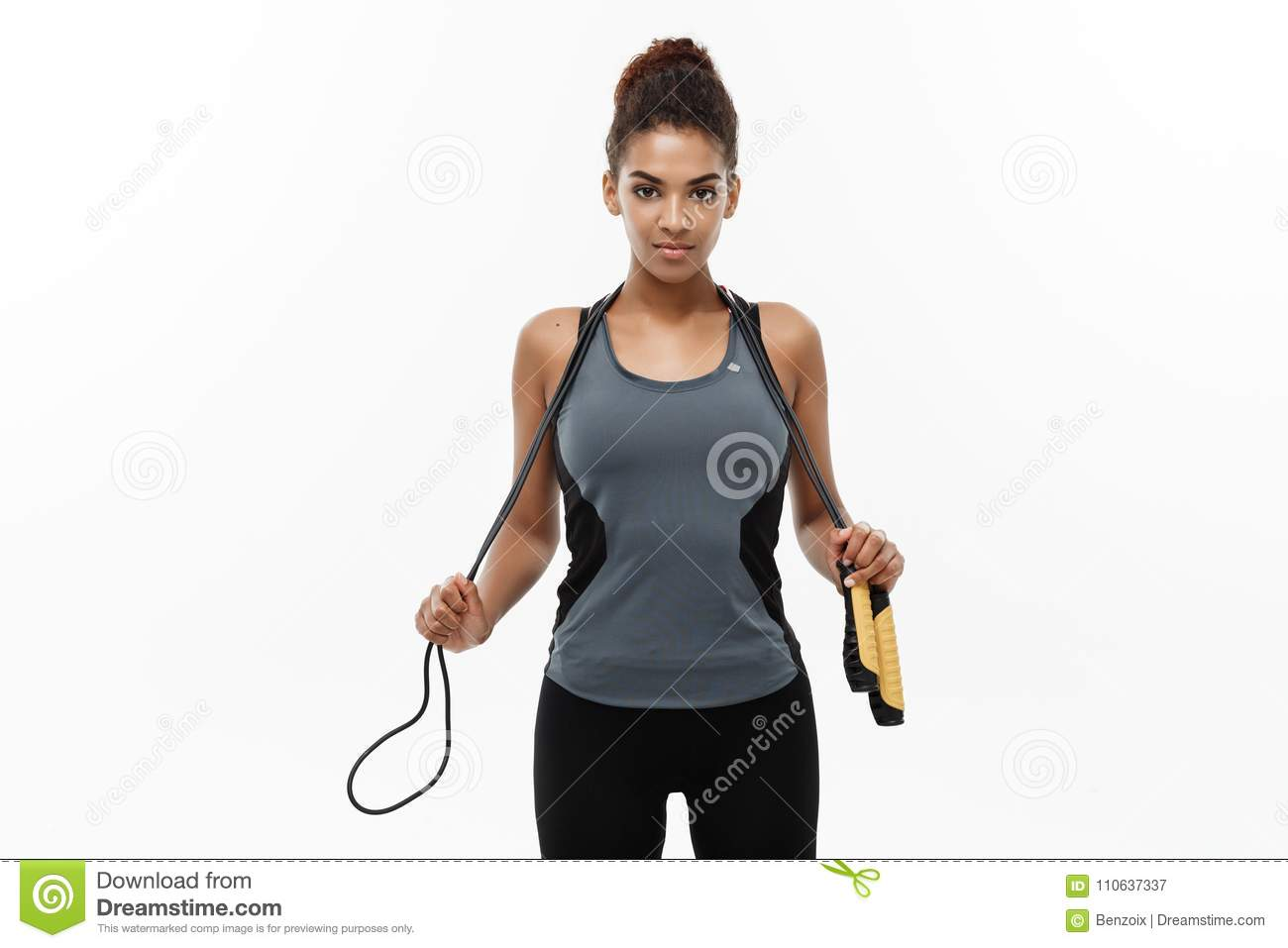 Sport, training, lifestyle and Fitness concept - portrait of beautiful happy African American woman exercising with