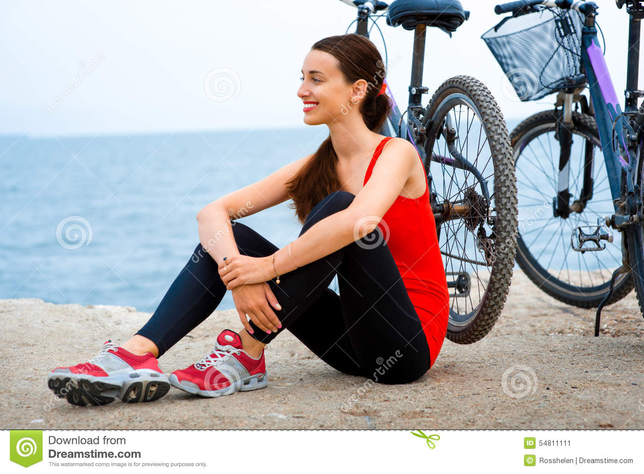 Sport woman with bicycles on the beach stock photo image for Sports shirts near me