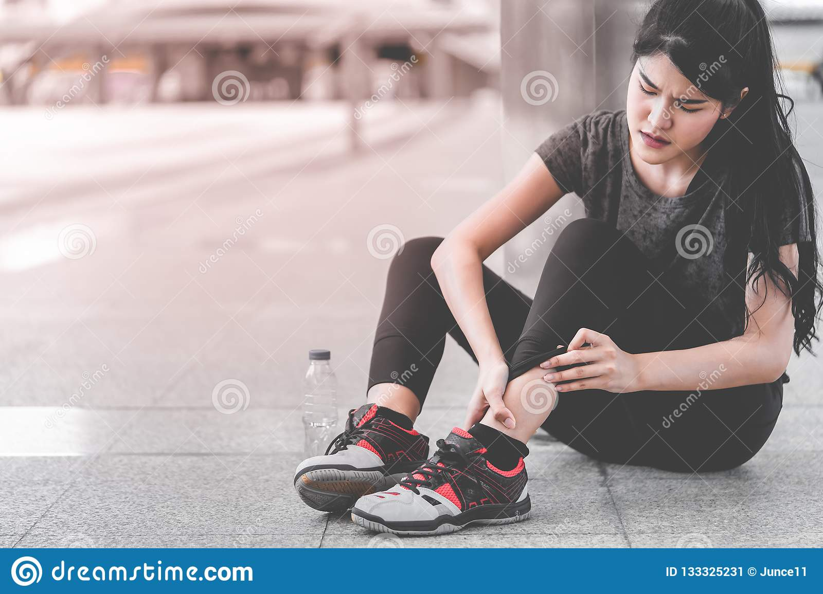 Sport woman having an injury on her ankle foot