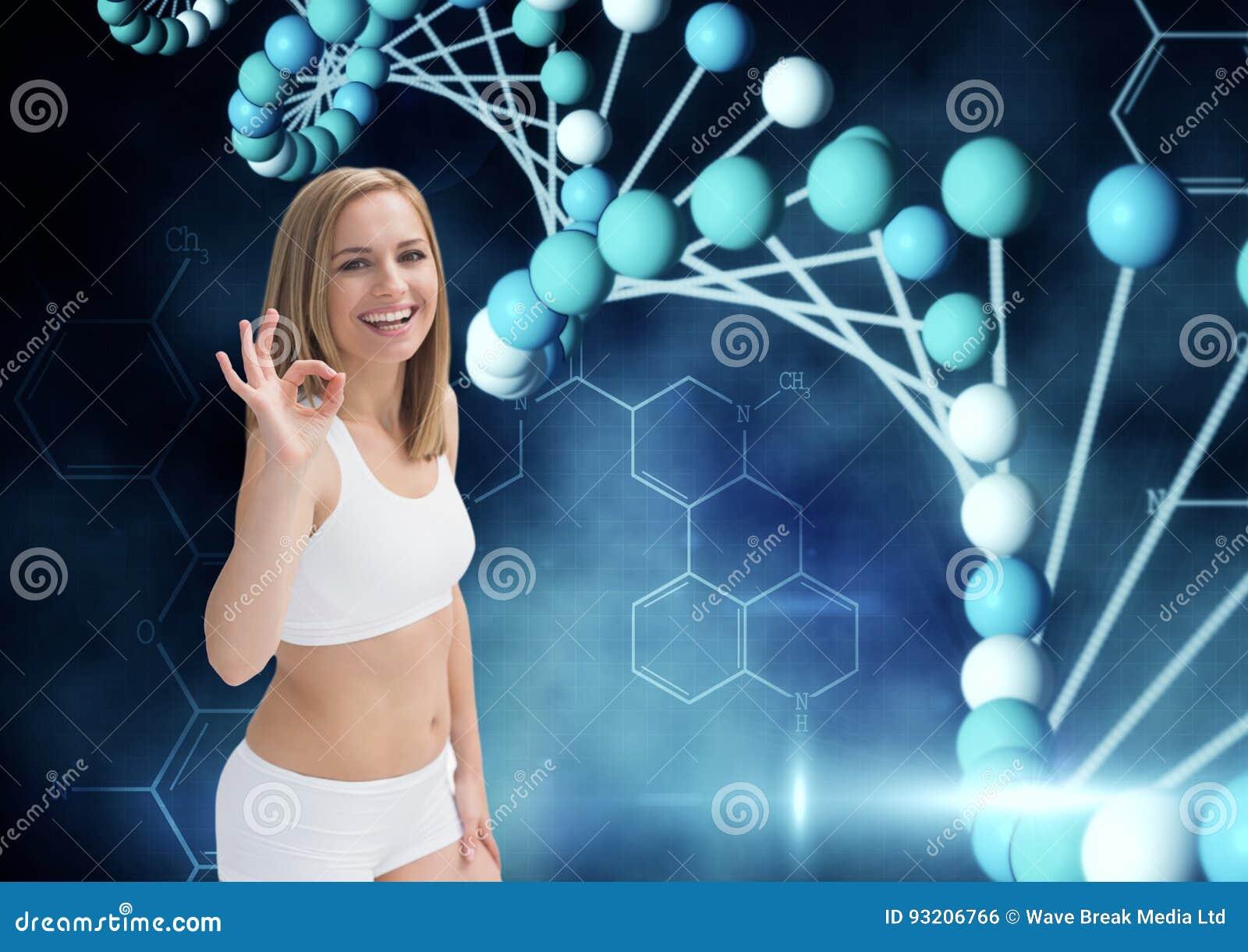 Sportieve vrouw die o.k. met de hand met DNA-ketting en donkerblauwe achtergrond zeggen
