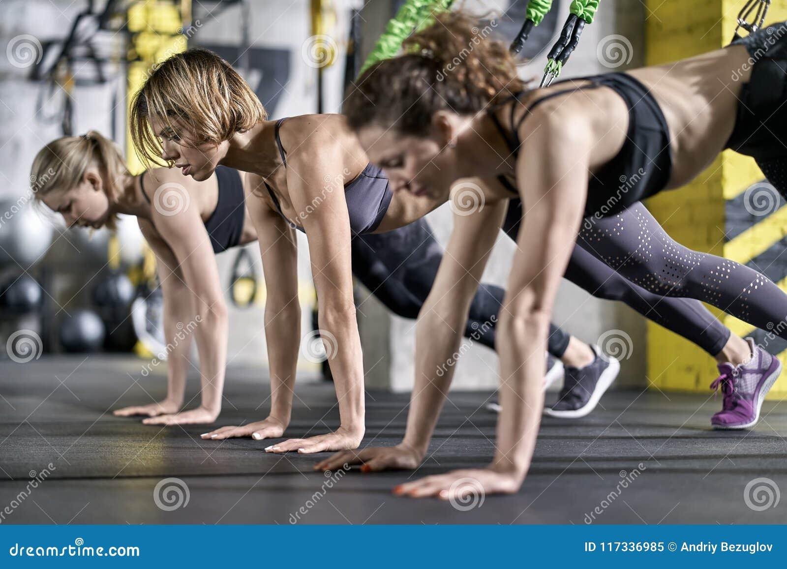 Sportive Girls Training In Gym Stock