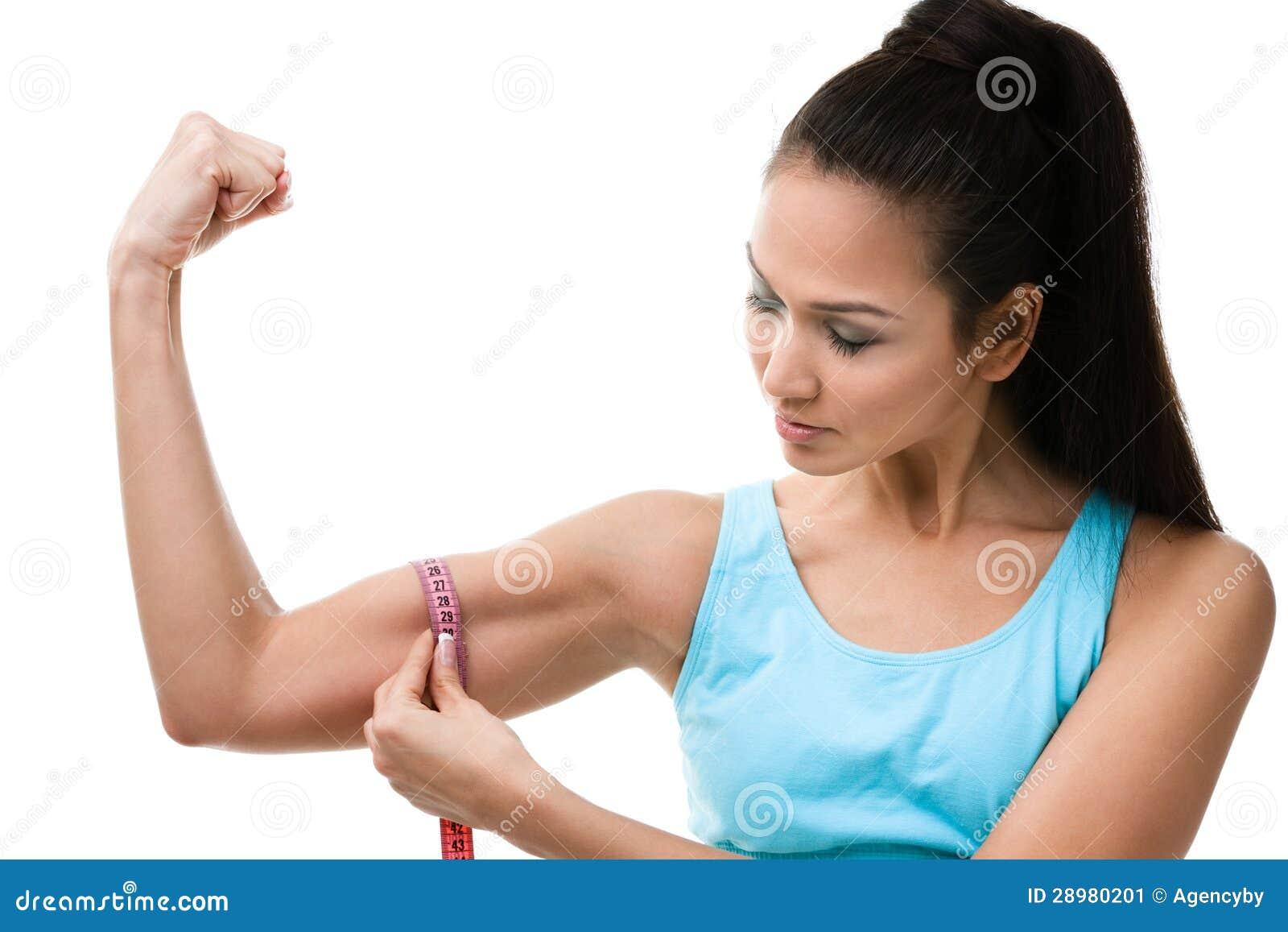 sportive woman measures her bicep stock image image 28980201. Black Bedroom Furniture Sets. Home Design Ideas