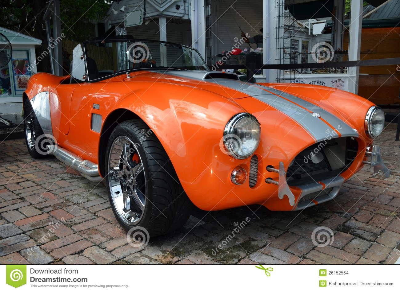 Vintage classic sports car on display in front of a key west shop on