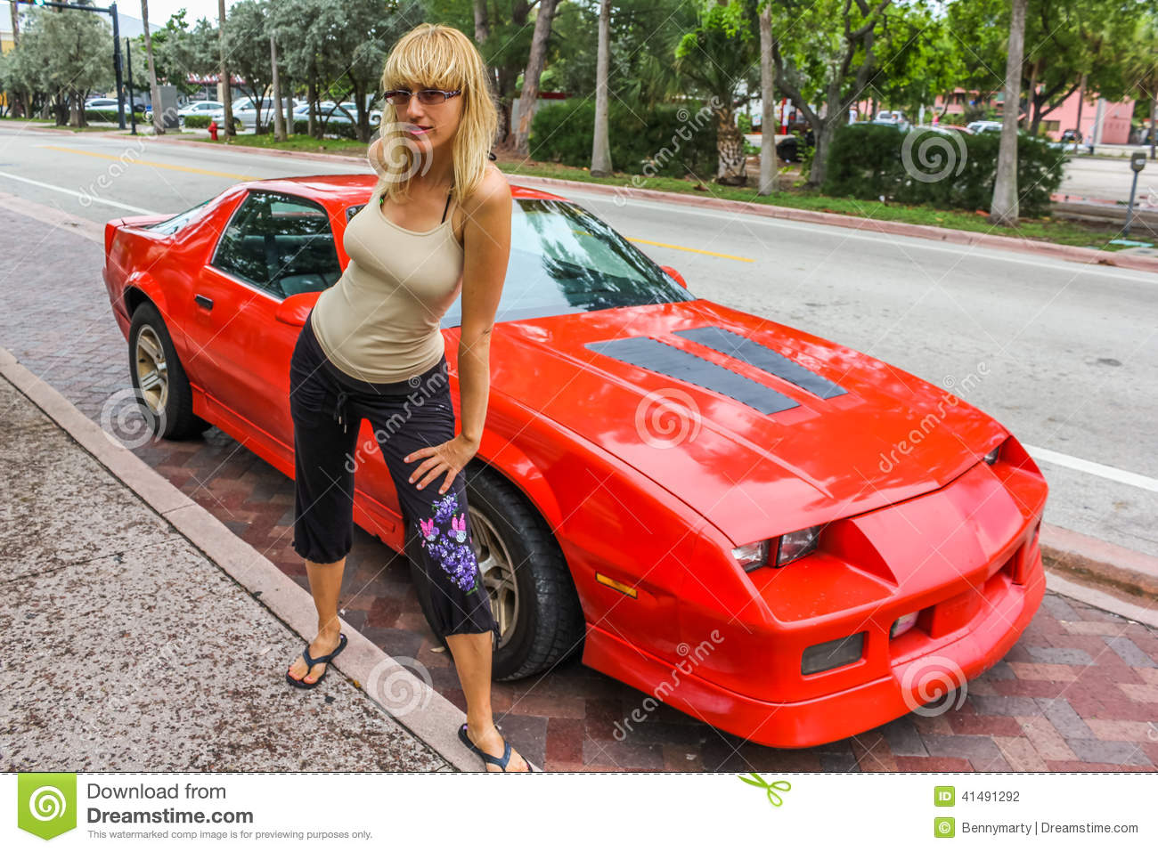 Nude girl with sports car valuable