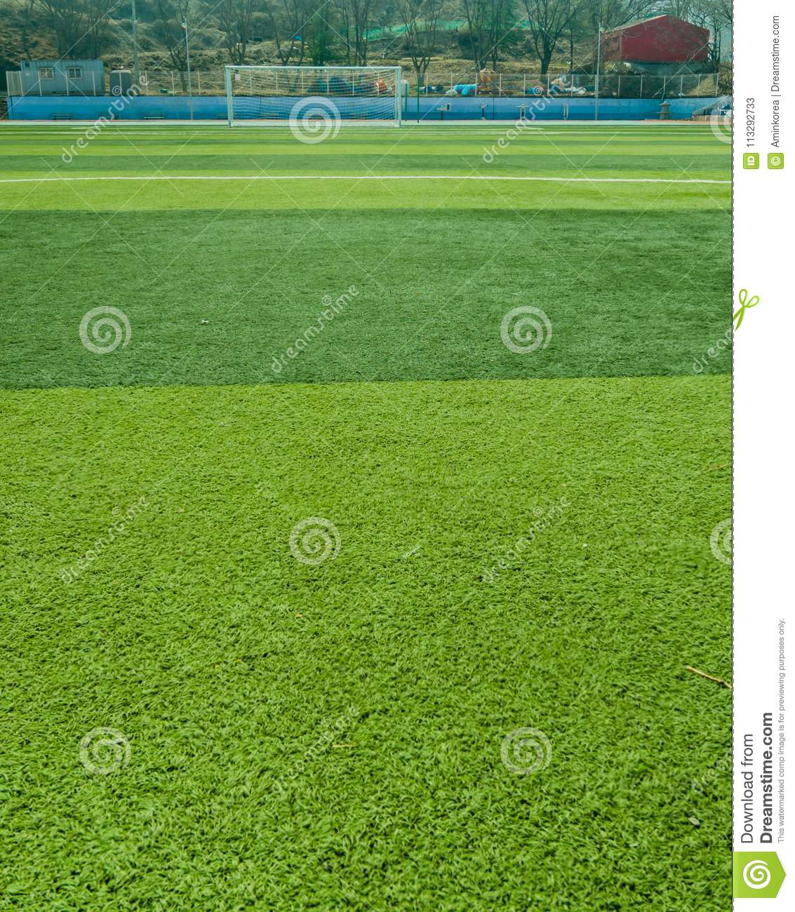Sports field covered with green artificial grass