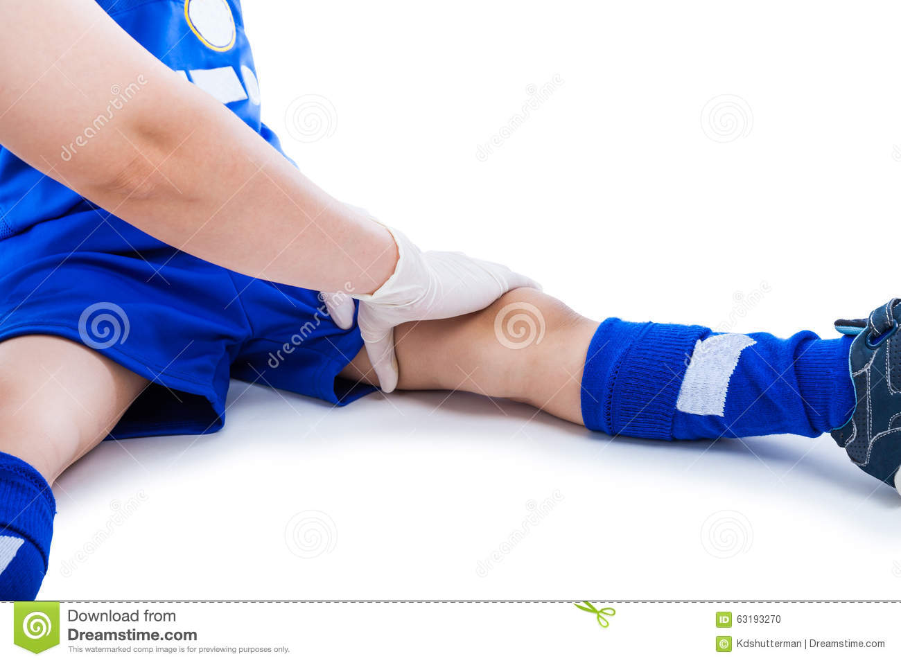 Sports Injury Doctor First Aid At Thigh Of Soccer Player Isola