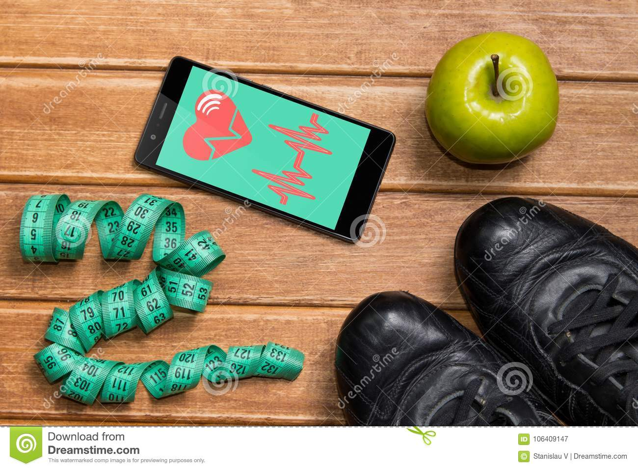 Sports Shoes , Apple , Measuring Tape And A Phone With
