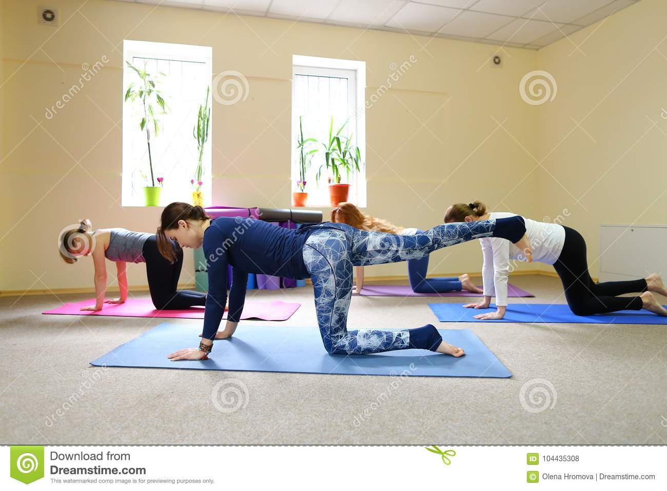Beautiful Girls Stretches Back Muscles In Yoga Positions Stock Photo