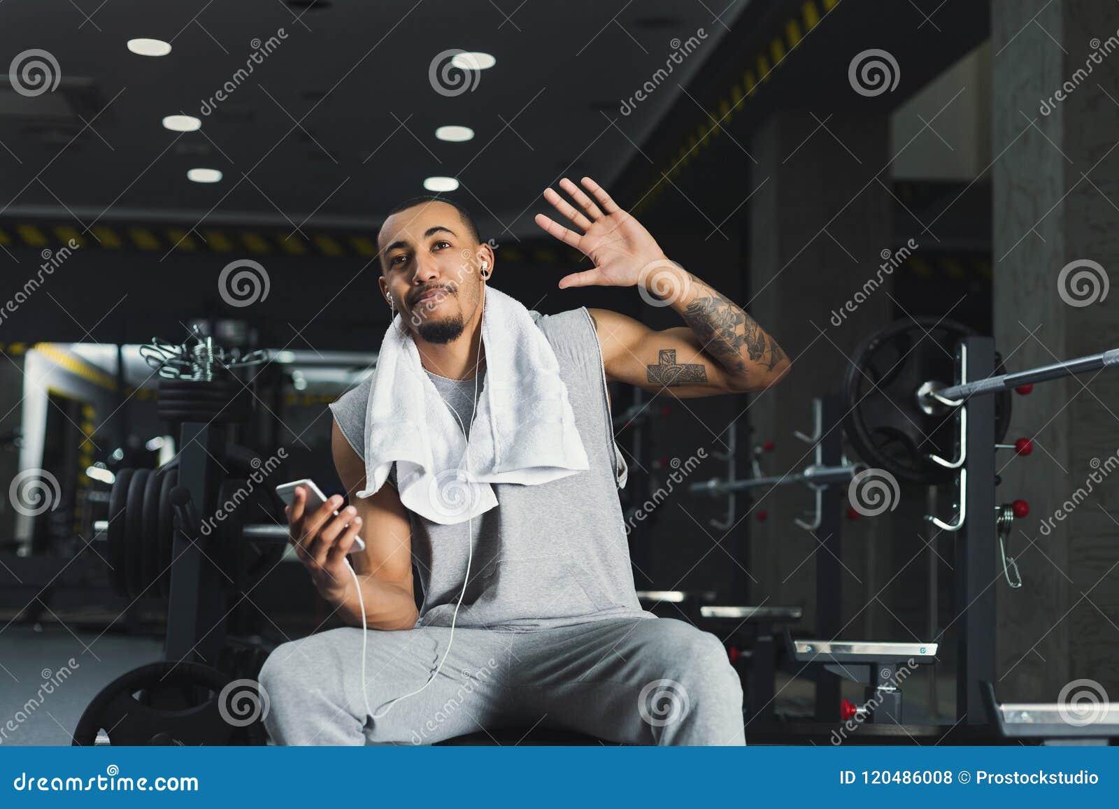 Sportsman In Headphones Choose Music On Phone Stock Photo Image Of