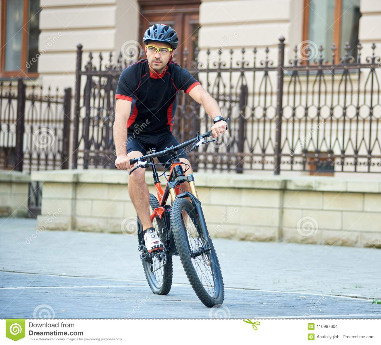 Sportsman Riding Bike Next To Old Building Stock Photo - Image of ... f803f90a1
