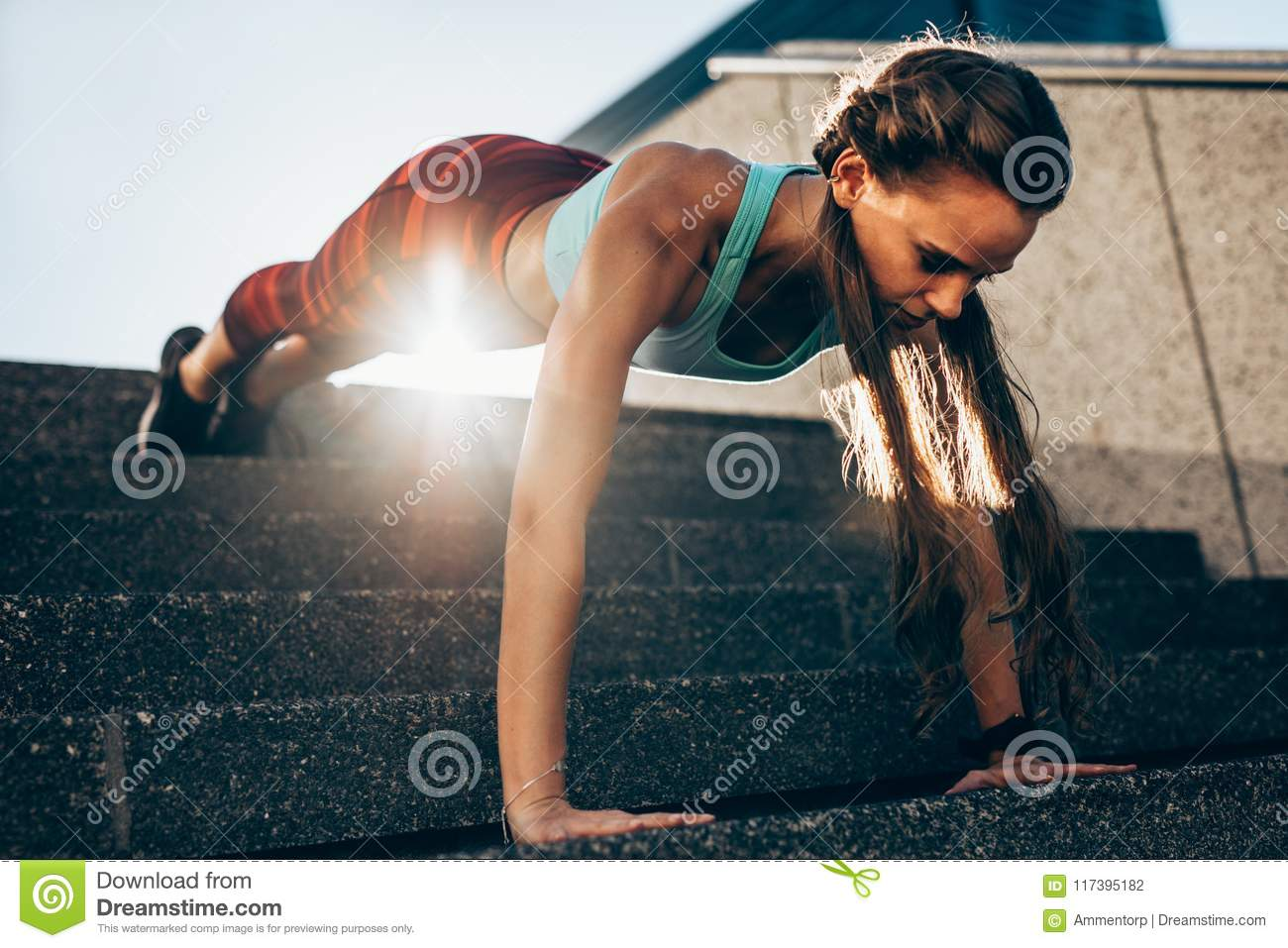 Sportswoman Doing Push Ups On Steps Stock Photo - Image of