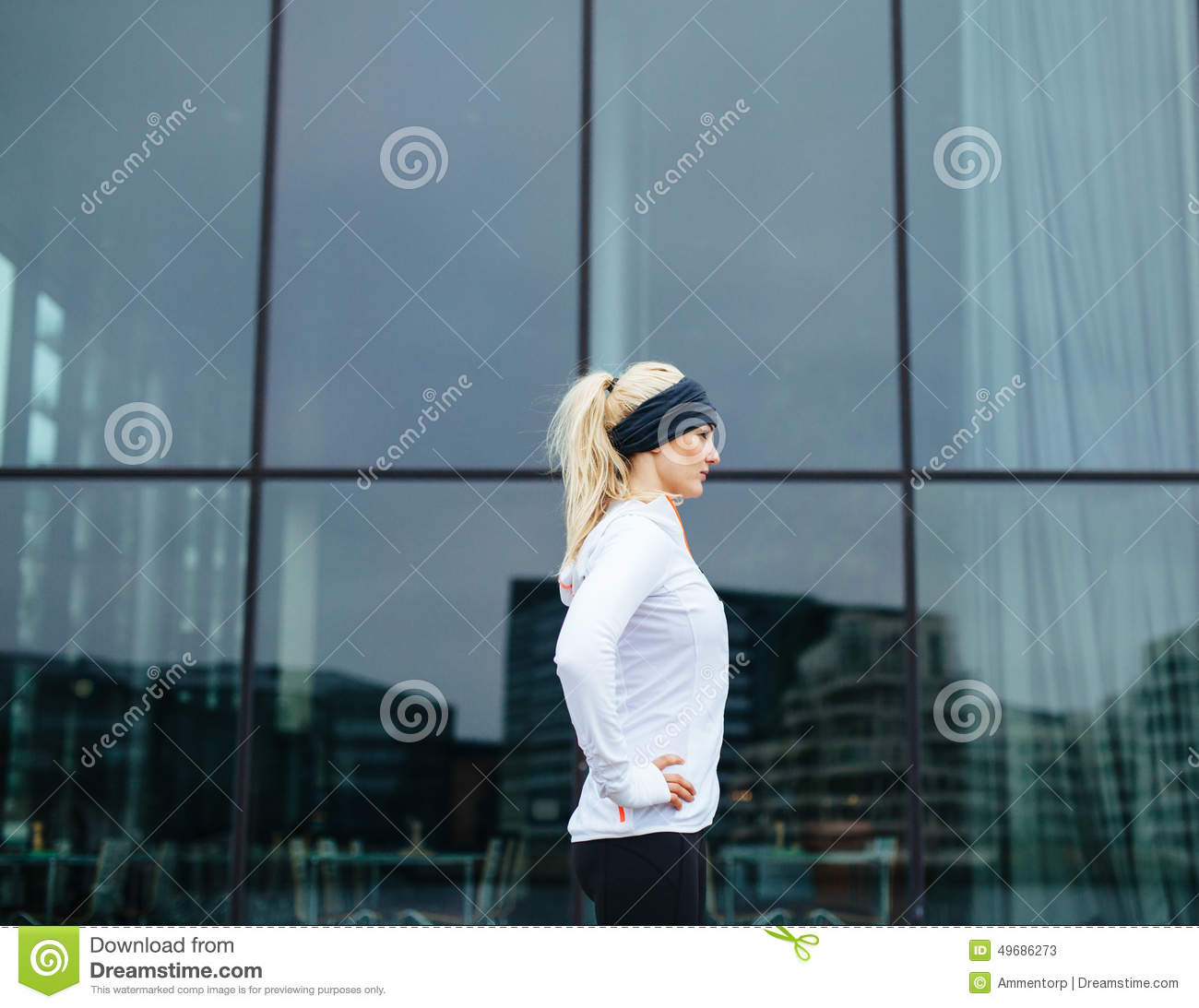 Sporty female ready for her outdoor training session