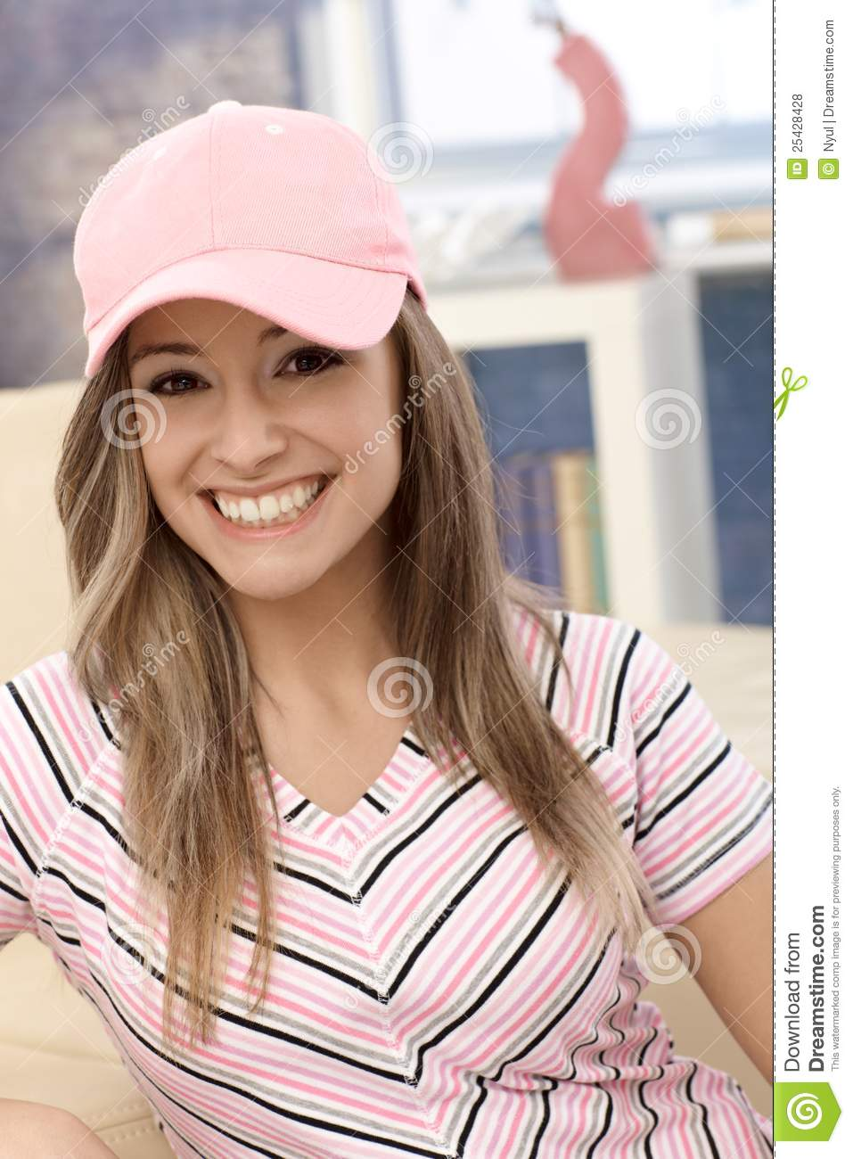 Sporty Girl In Baseball Cap Smiling Royalty Free Stock