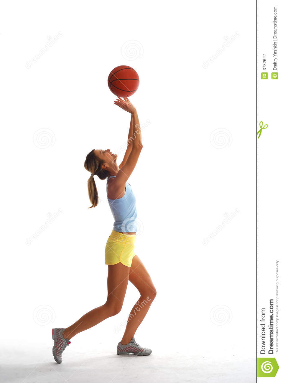 Sporty girl with basket ball