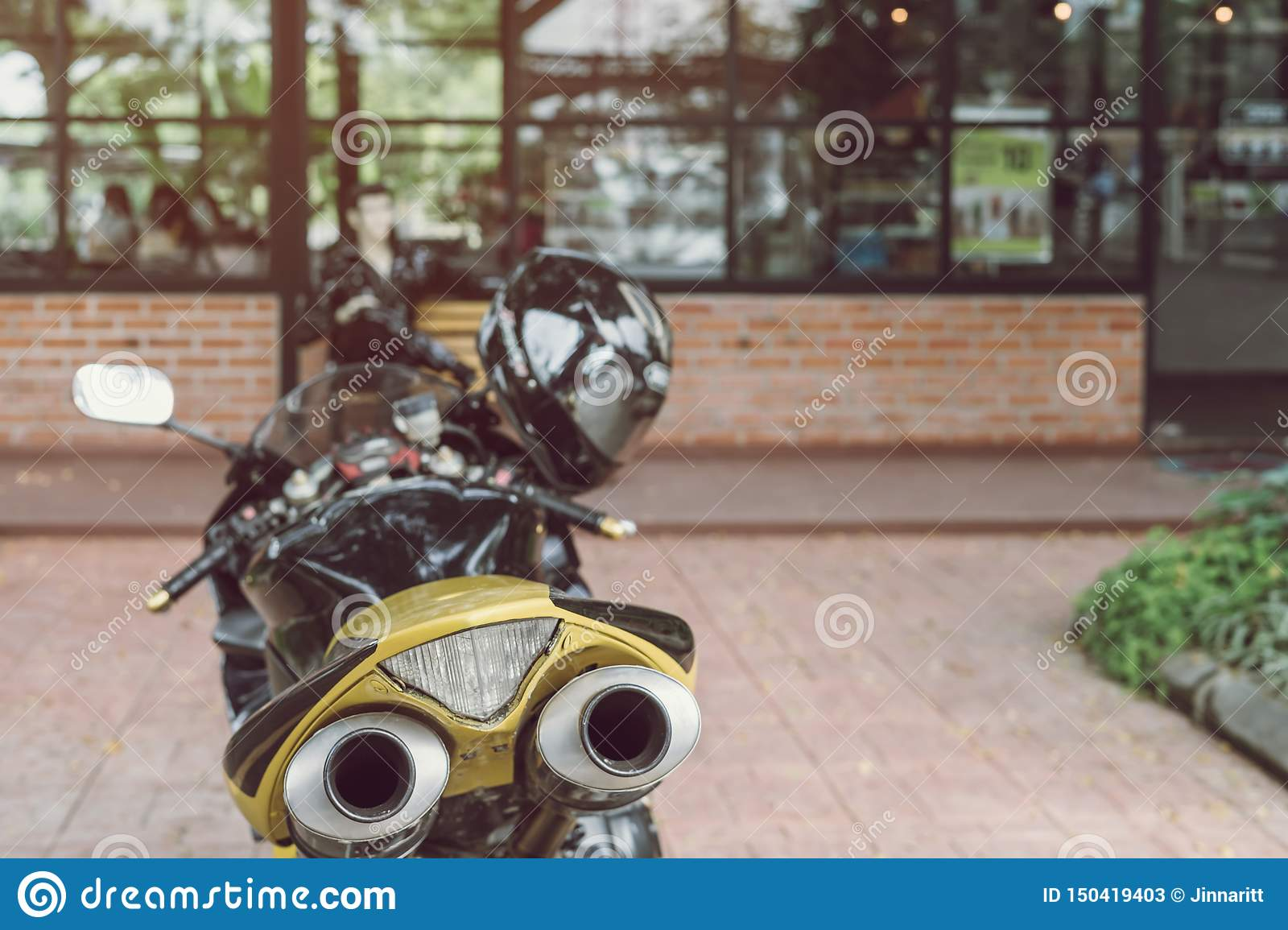 A sporty motorcycle parked in front of coffee shop