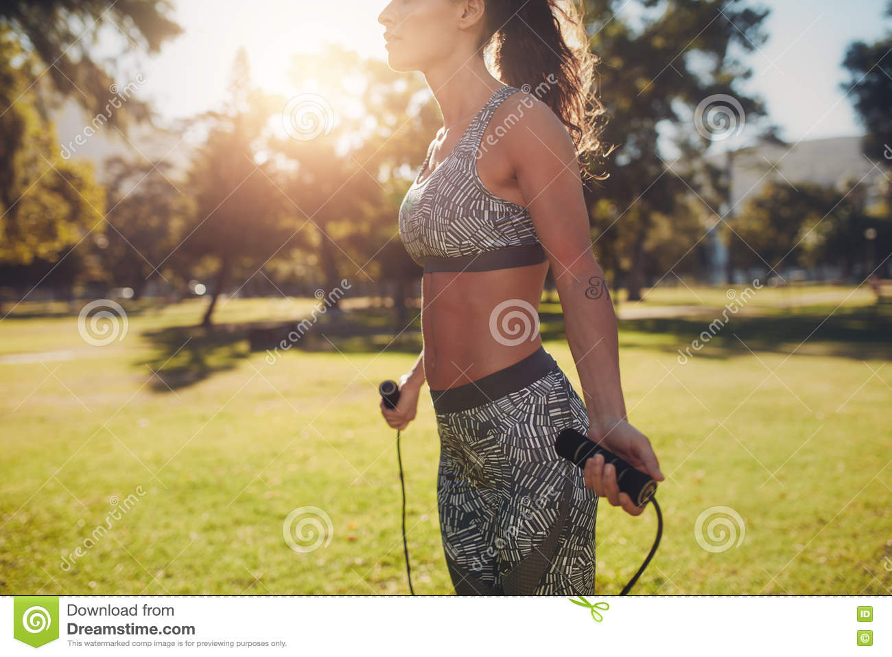 Sporty woman skipping in a park