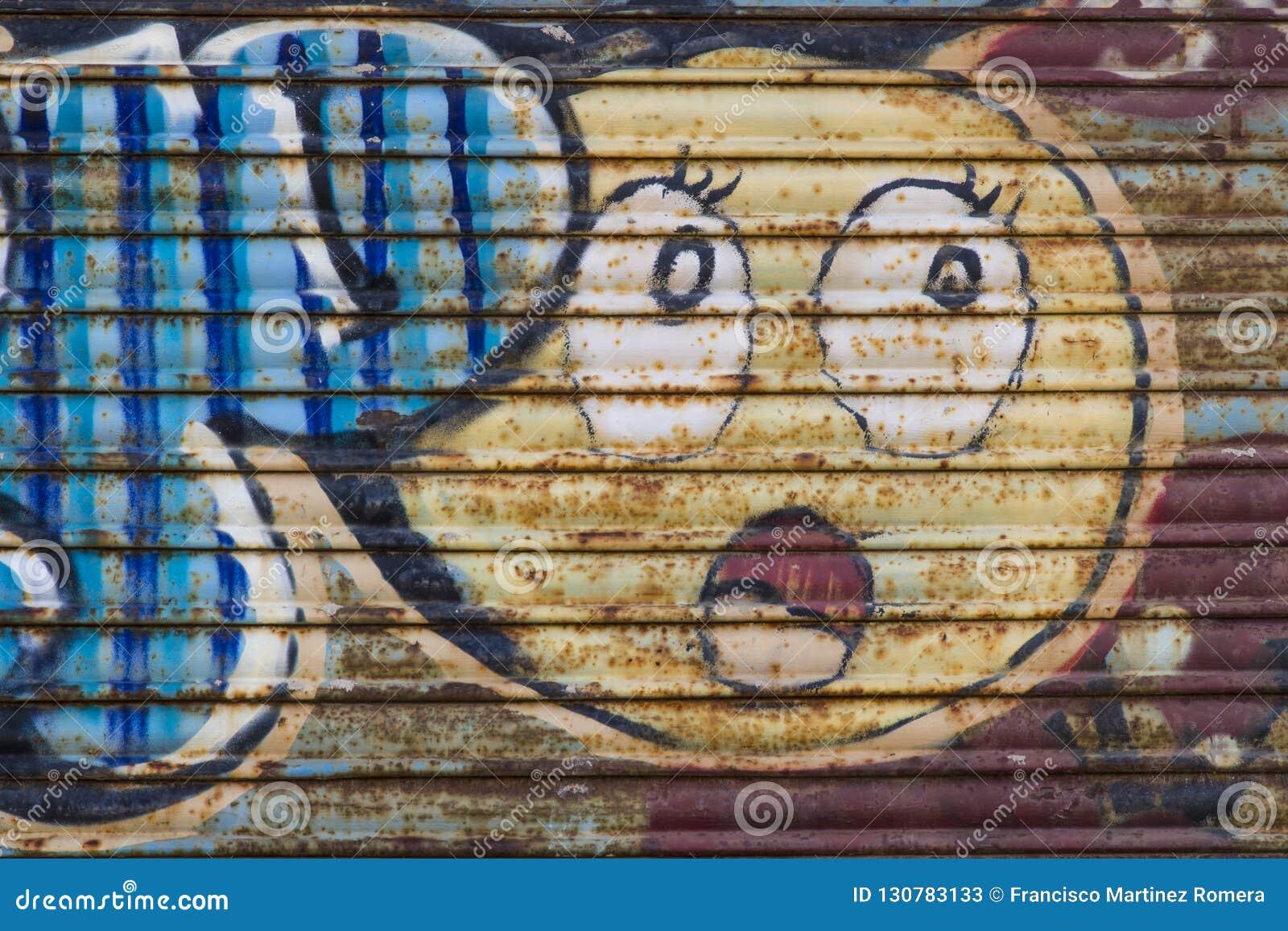 Spray painted graffiti on metal blind