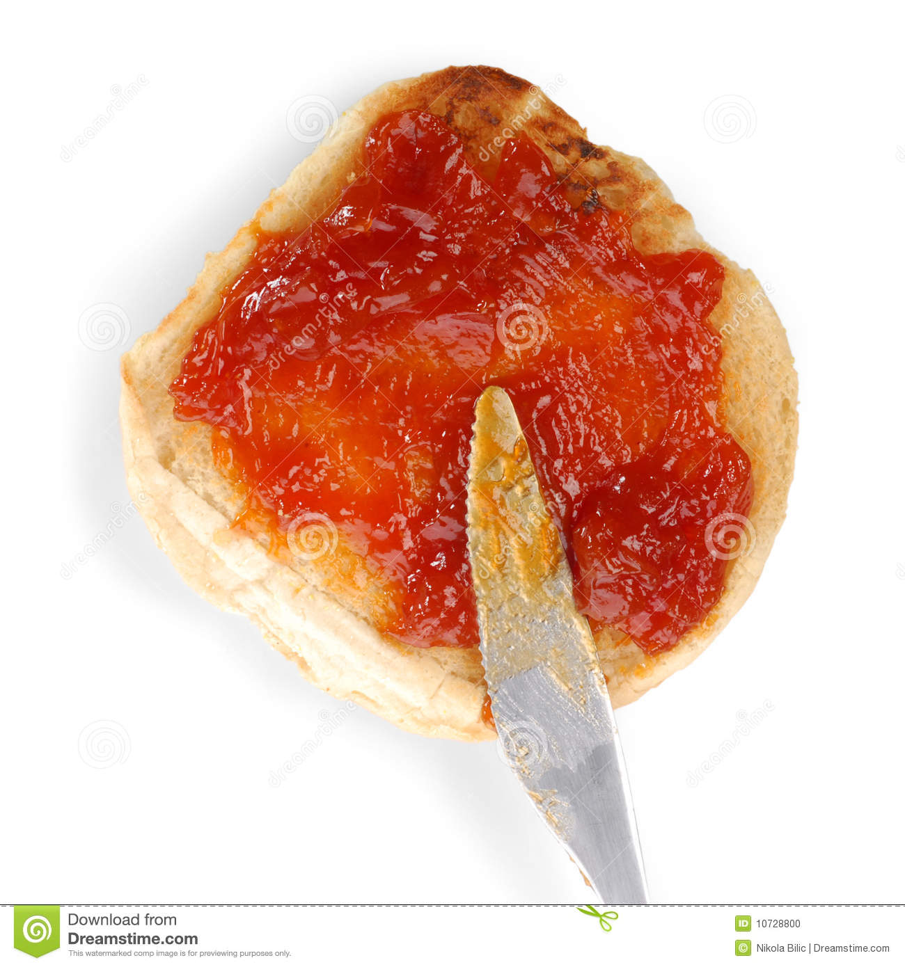 Jam spread being spread onto a piece of bread.
