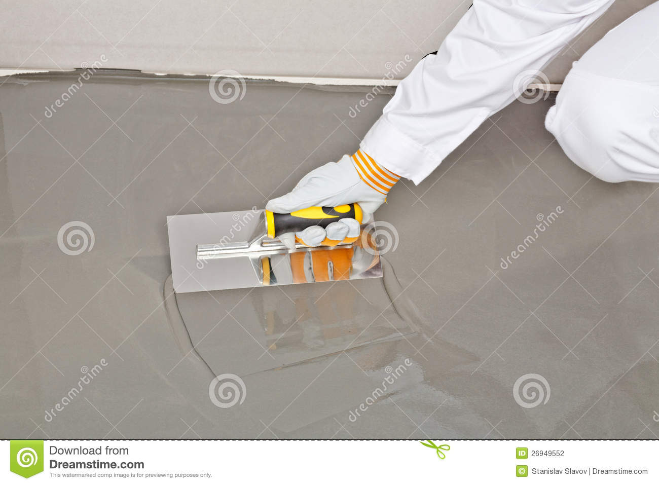 Self Leveling Thinset : Spreading self leveling compound with trowel stock