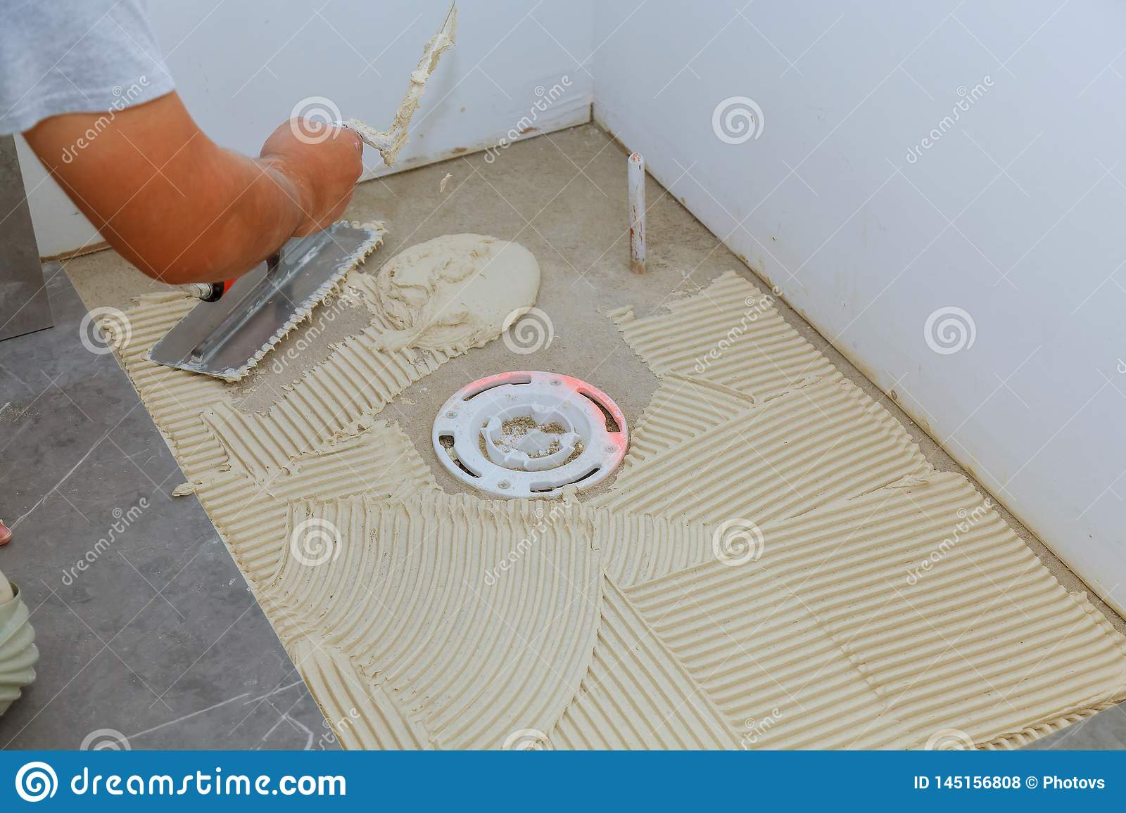 Spreading Wet Mortar Before Applying Tiles On Bathroom Floor Stock Photo Image Of Interior Hand 145156808