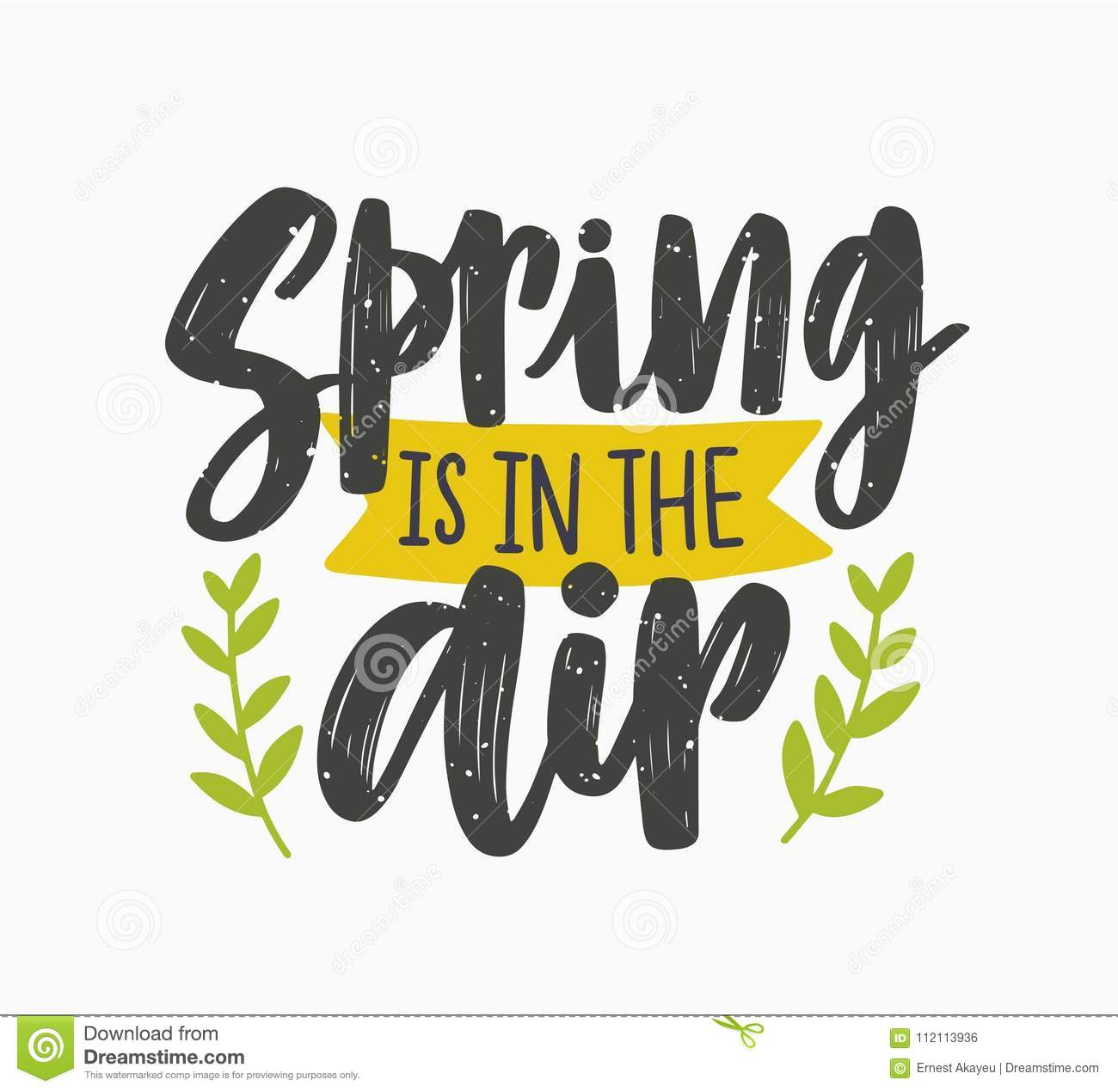 Spring Is In The Air Inspiring Phrase Written With Artistic Cursive Font Or Script And Decorated Green Leaves