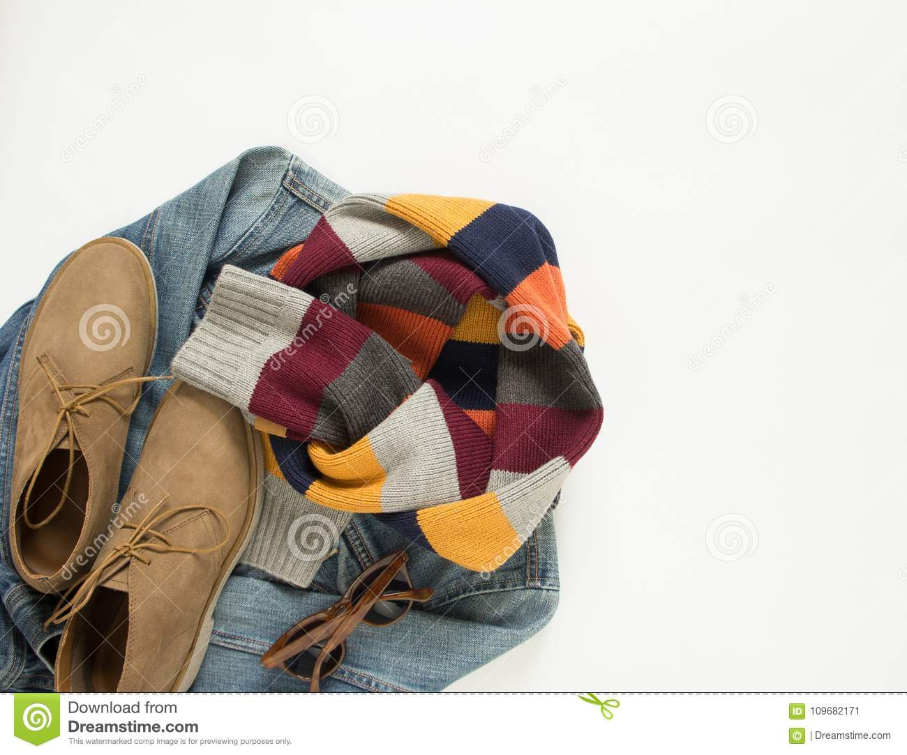 Spring, autumn female outfit. Set of clothes, shoes and accessories on white background. Blue denim jacket, stripe scarf and cream