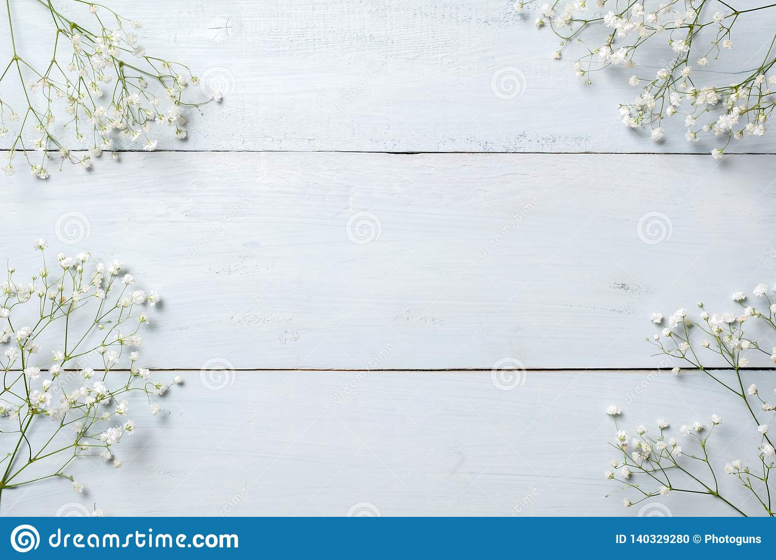 Spring background, flowers frame on blue wooden table. Banner mockup for Womans or Mothers Day, Easter, spring holidays. Flat lay,