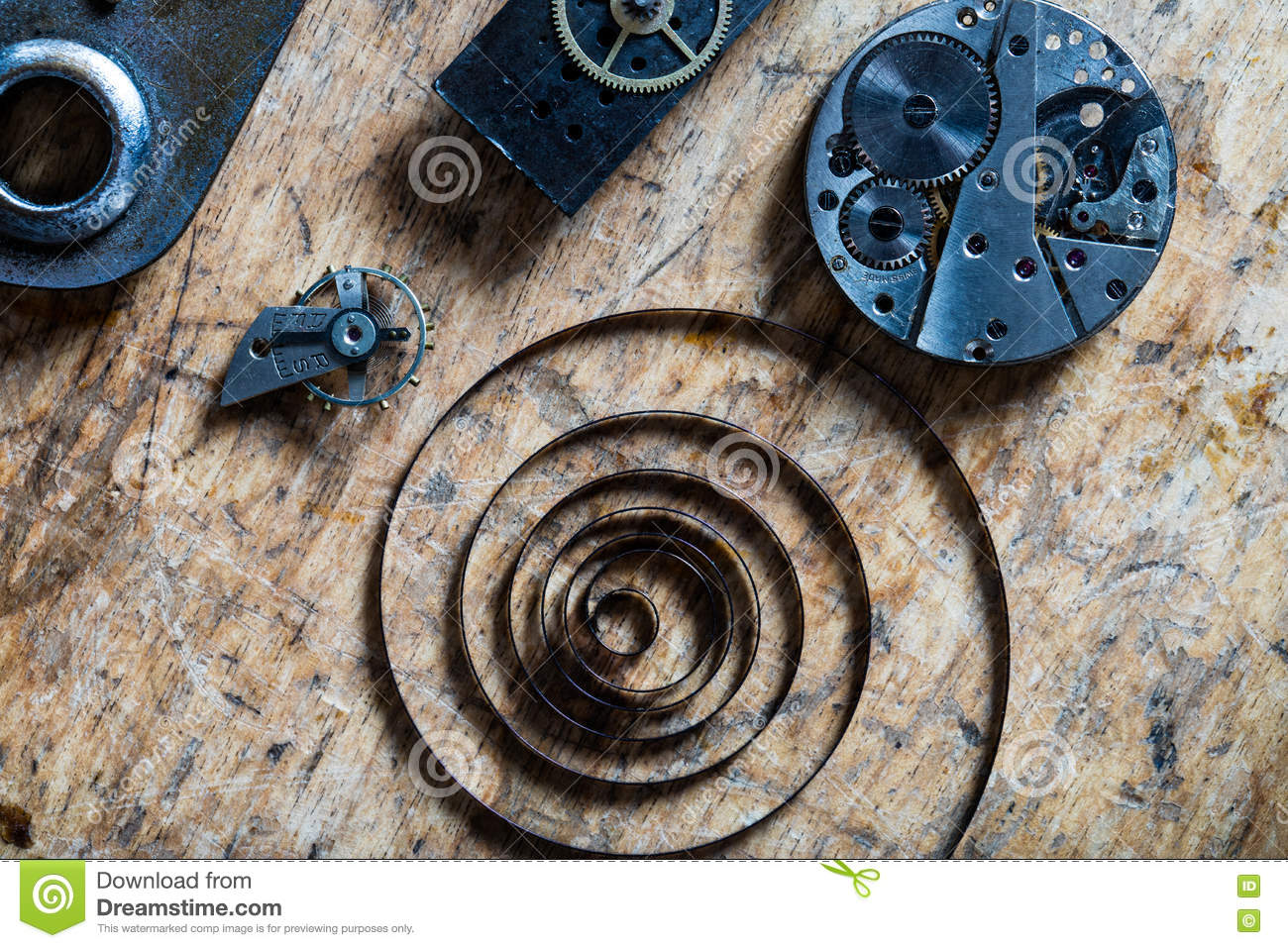 Spring, balance wheel and clockworks on a table