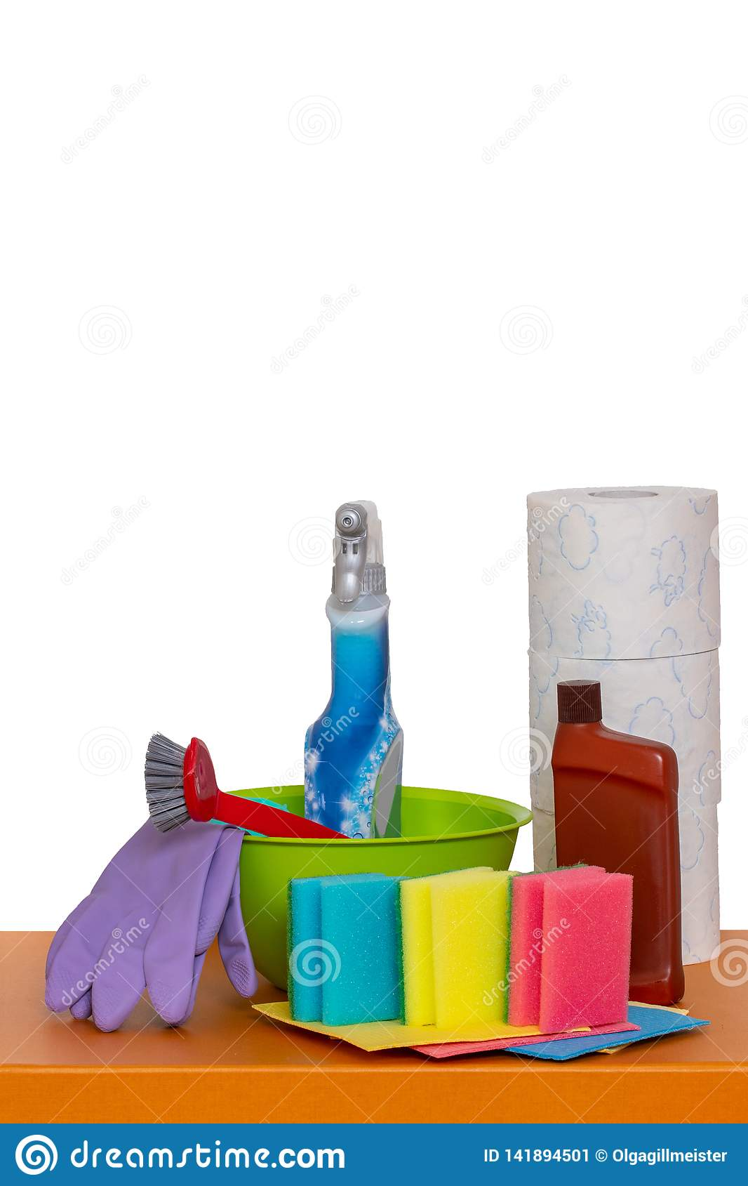 Spring cleaning background. Close-up of house cleaning products and cleaning supplies on orange wooden table isolated on a white